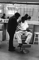 The barbershop at the Boys Training School, pictured in 1971. Established in 1856, the school served as a reform school for boys until it closed in 1972.