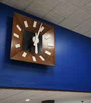 A large wooden clock at the offices of Doolittle & Associates - An Ameriprise Financial Services, Inc. practice at 122 S. Cochran Ave. in downtown Charlotte on Monday, Nov. 12, 2018.