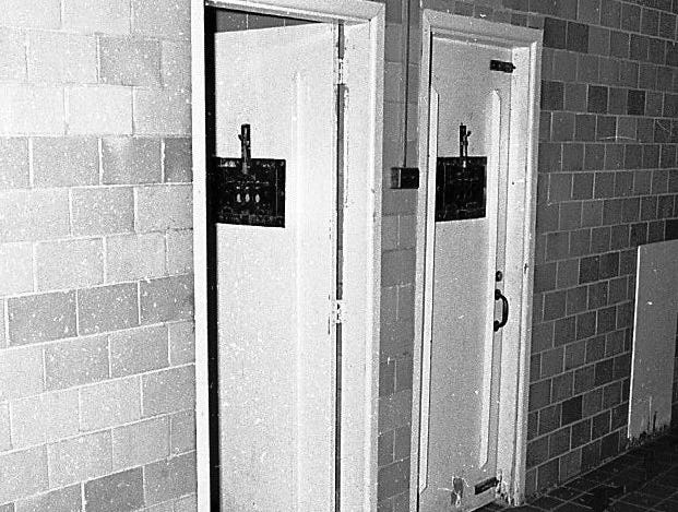 This 1968 photo shows a hallway in one of the campus buildings at the Boys Training School in Lansing. Established in 1856, the school served as a reform school for boys until it closed in 1972.