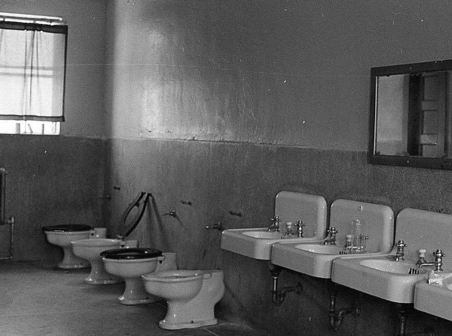 This 1971 photo shows a bathroom in the Boys Training School in Lansing. Established in 1856, the school served as a reform school for boys until it closed in 1972.