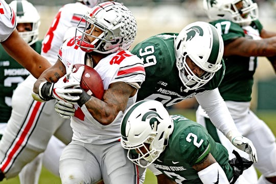 MSU's Raequan Williams, right, and Justin Layne, bottom, will have to decide whether they want to leave for the NFL or headline a potentially ferocious Spartan defense in 2019.