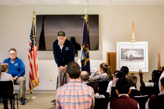 World War II veteran Dick Thelen, 91, speaks to students at St. Martha's School in Okemos, Michigan.