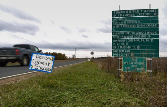 It wasn't difficult in early November to spot signage along Clintonia Road that showed support for the Pewamo-Westphalia football team. The villages of Pewamo and Westphalia each have less than 1,000 residents.