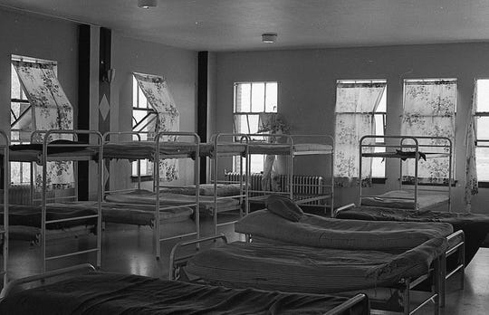 This 1971 photo shows one of the sleeping quarters at the Boys Training School in Lansing. Established in 1856, the school served as a reform school for boys until it closed in 1972.