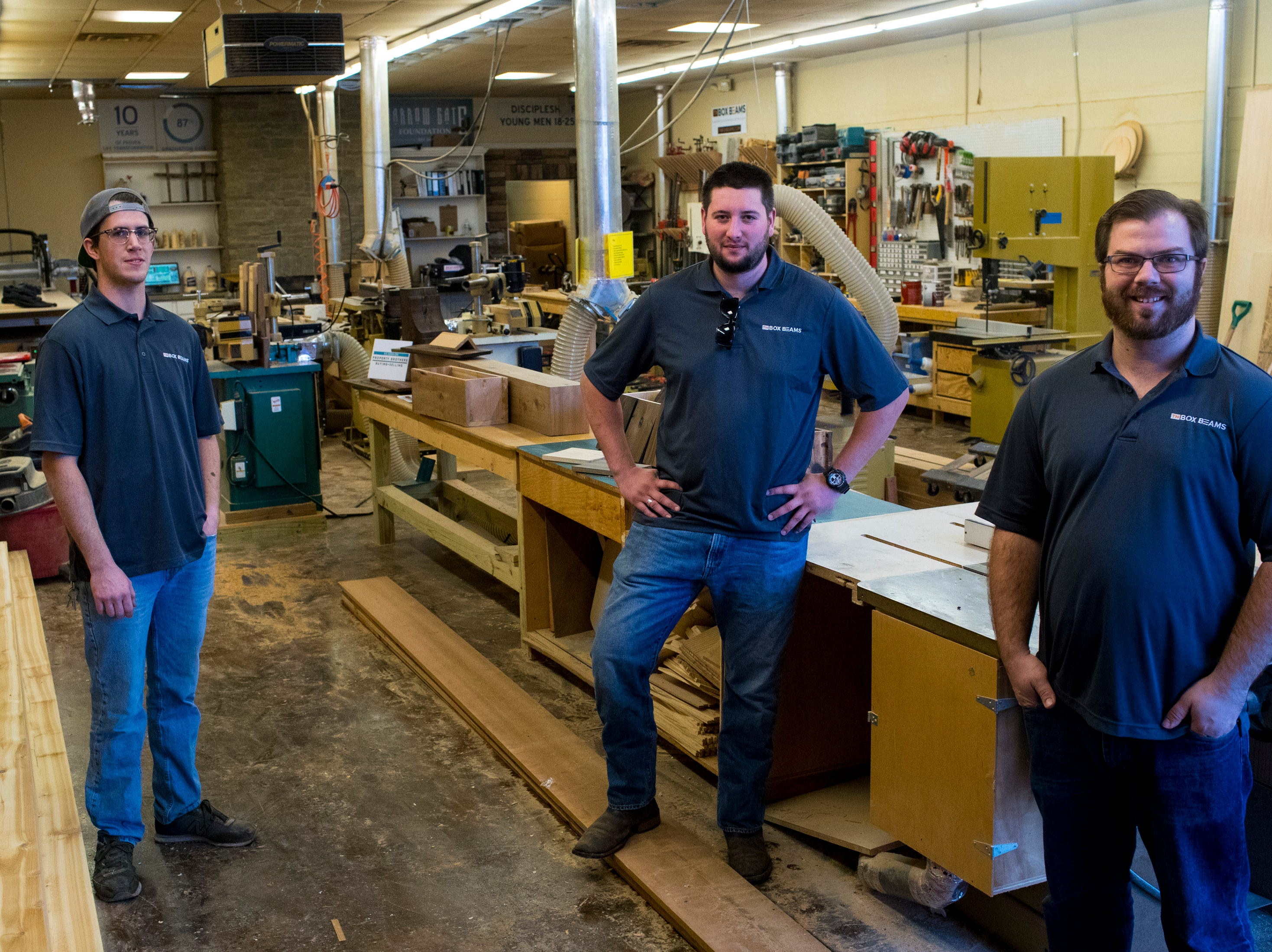 TN Box Beams representative Kenny Bowling, right, Colin Hemberg, center, and Heath Hill at TN Box Beams in Franklin on Friday, Nov. 9, 2018. TN Box Beam will be featured on the HGTV show Property Brothers Buying + Selling on Nov. 14.