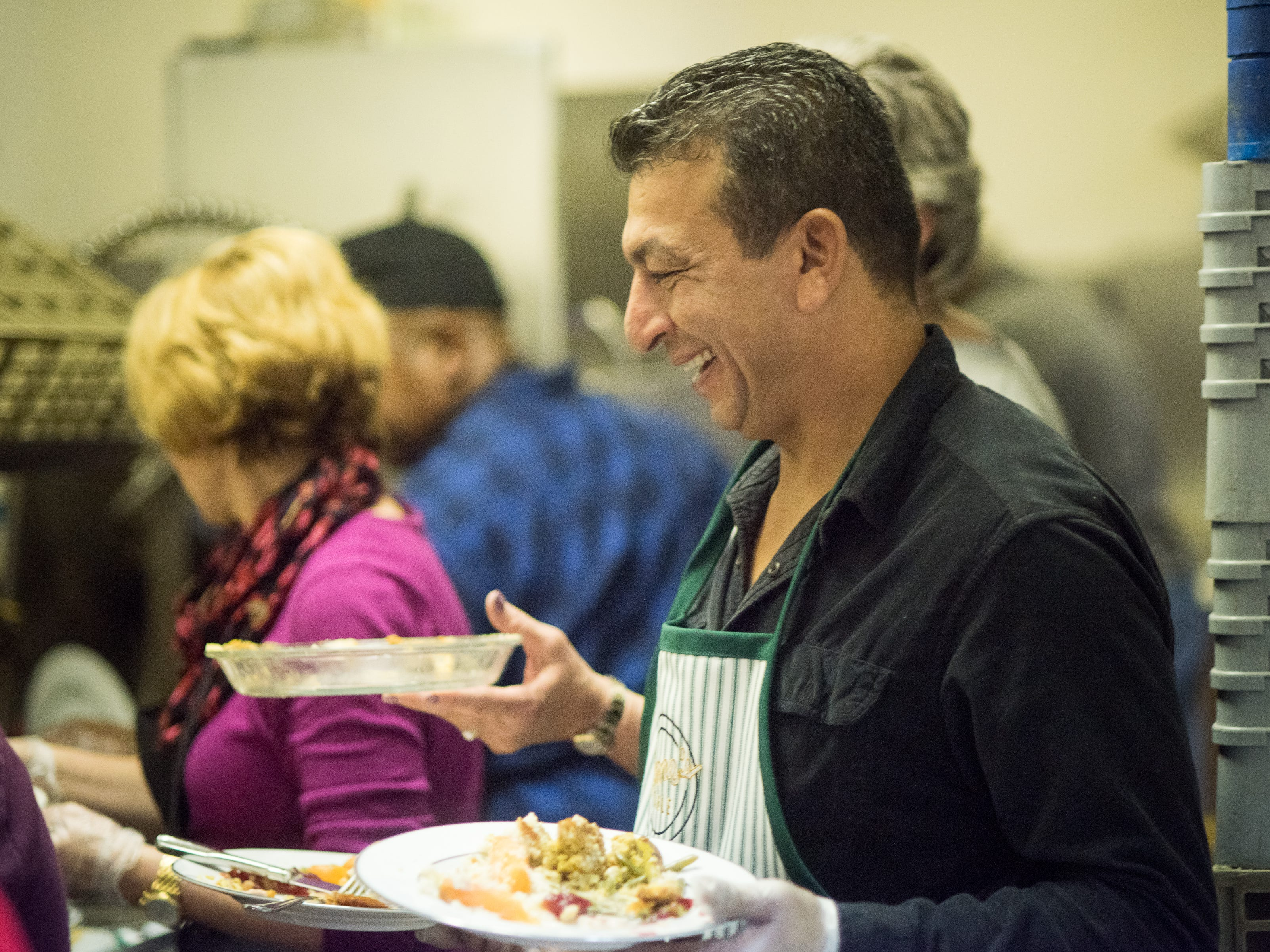 Friends and customers volunteer their time on Thanksgiving Day to help Napa Cafe owner Glenda Hastings and her staff serve a turkey dinner to the homeless.