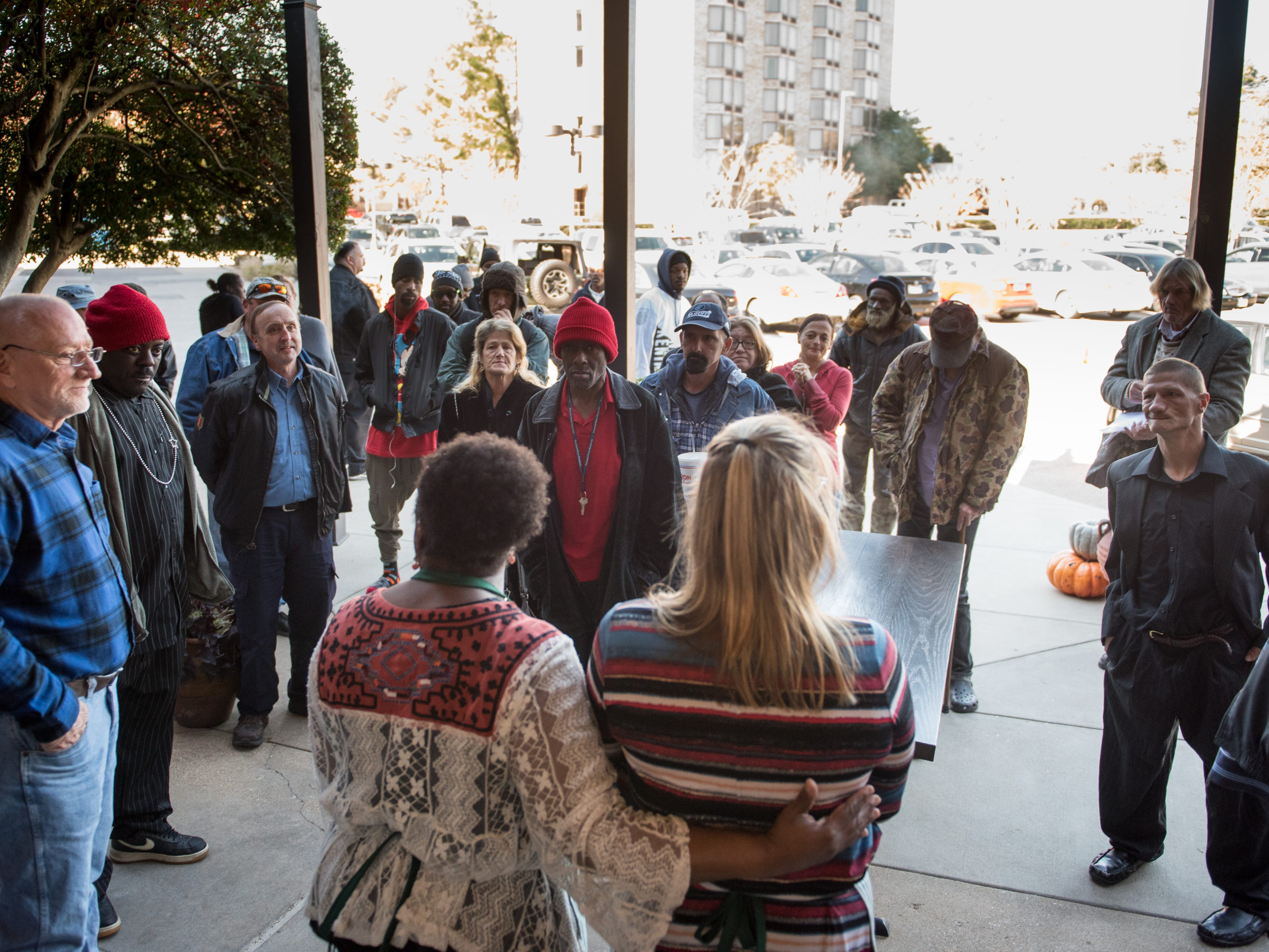 Napa Cafe owner Glenda Hastings, on the right, welcomes her guests at her annual Donna's Table Thanksgiving Feast. Since 2015, she has been opening her restaurant on Thanksgiving Day to feed the homeless.