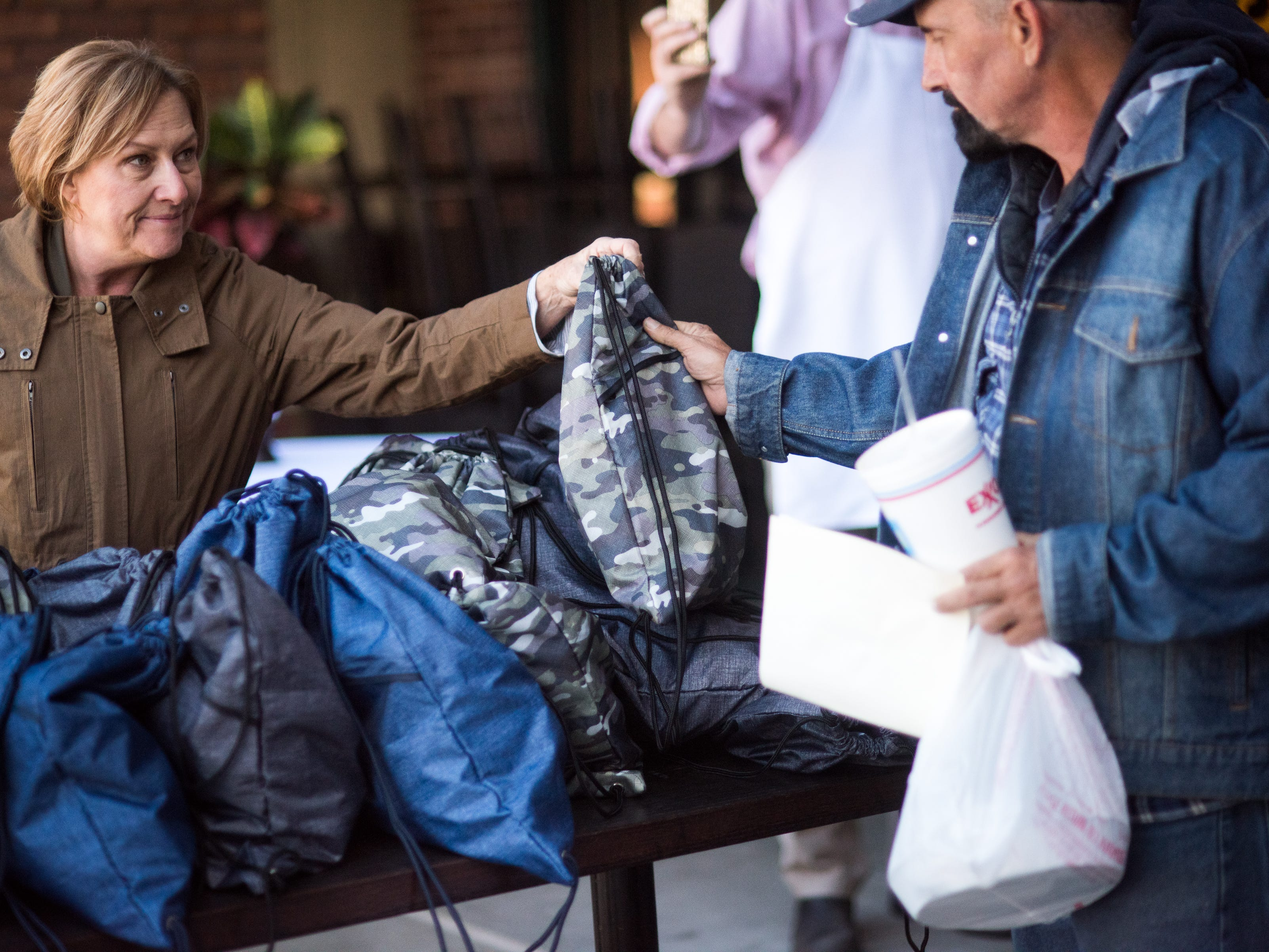After enjoying a Thanksgiving feast at the annual Donna's Table event at Napa Cafe, homeless attendees receive a care package with essentials.