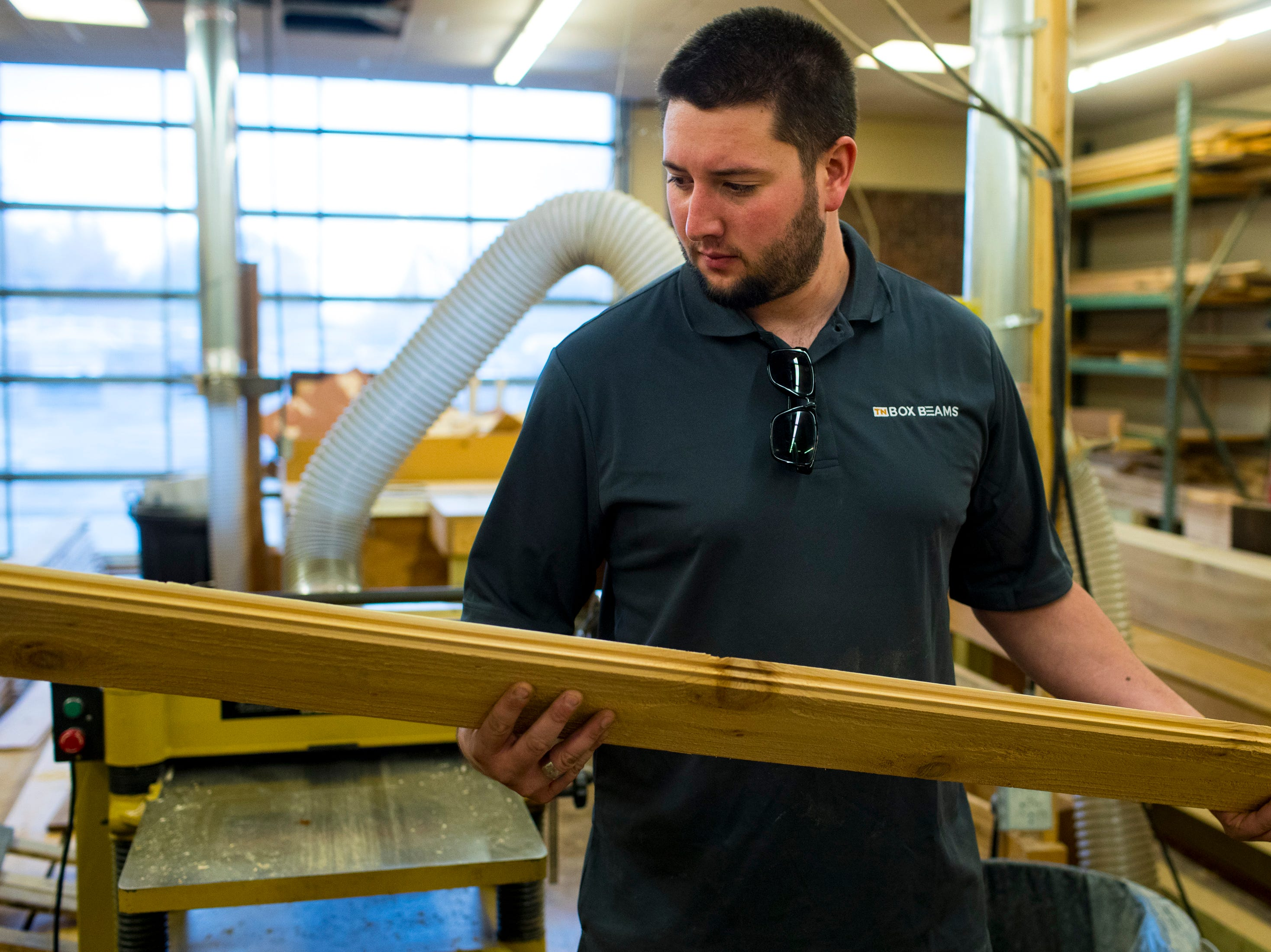 Colin Hemberg looks over a board at TN Box Beams in Franklin on Friday, Nov. 9, 2018. TN Box Beams will be featured on the HGTV show Property Brothers Buying + Selling on Nov. 14.