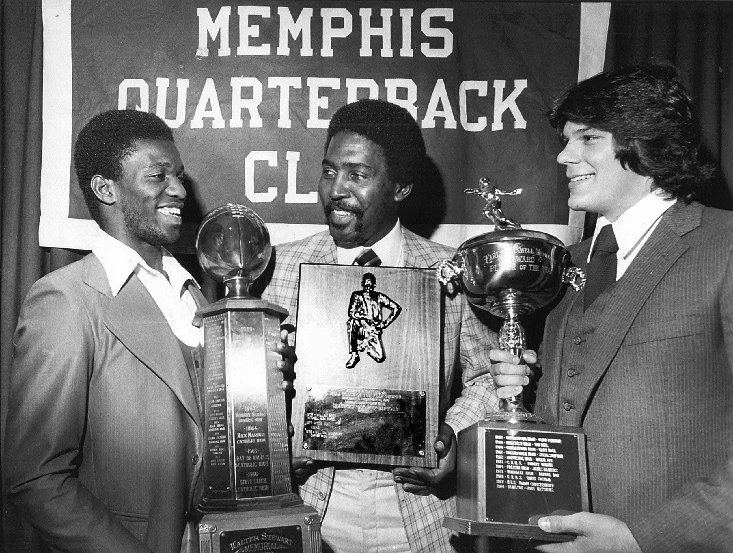 For their achievements on the football field in 1979, the Memphis Quarterback Club honored East quarterback Derrick Crawford (Left), East head coach James Fox (Center) and Craigmont lineman Mike Ihrie at a noon luncheon on 19 Nov 1979.  Crawford won the Walter Stewart Memorial Award as back-of-the-year.  Fox won the Joseph P. Gattas Jr. award as coach-of-the-year and Ihrie received the Early Maxwell Memorial Award as the city's top lineman.  White Station won the Sportsmanship award for the second consecutive year.