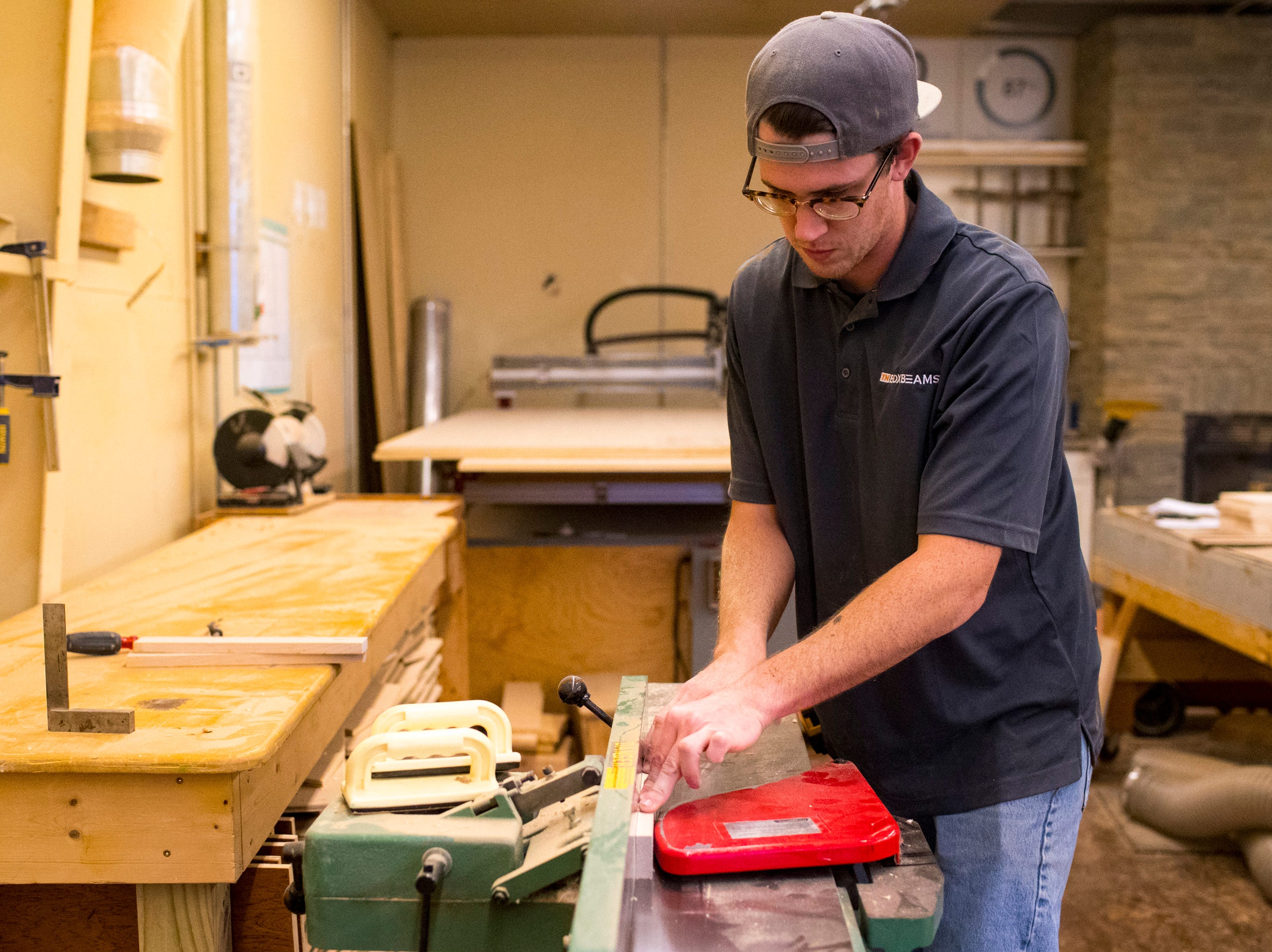 Heath Hill works to make a cutting board at TN Box Beams in Franklin on Friday, Nov. 9, 2018. TN Box Beams will be featured on the HGTV show Property Brothers Buying + Selling on Nov. 14.
