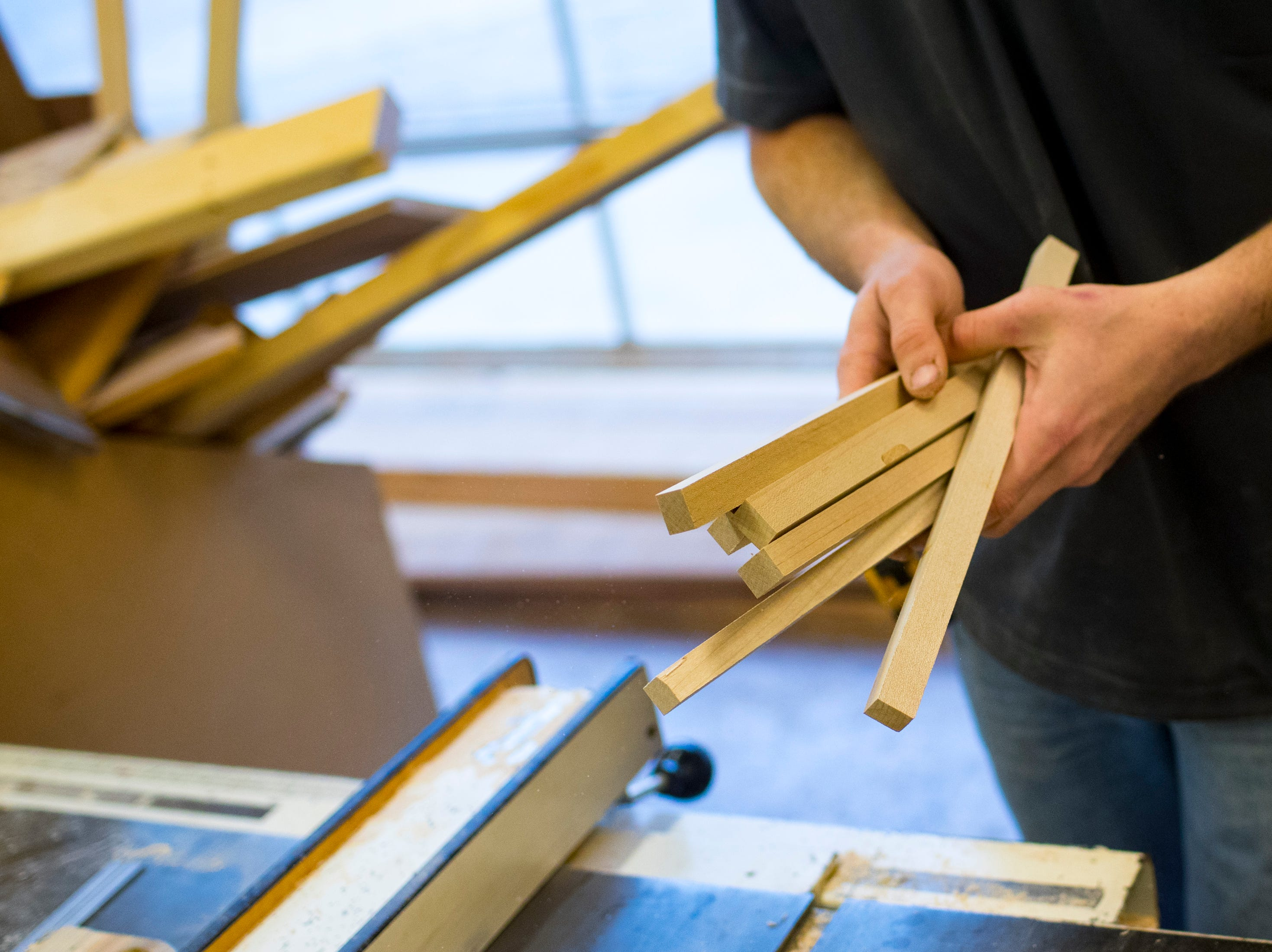 Heath Hill collects pieces of wood he will use to make a cutting board at TN Box Beam in Franklin on Friday, Nov. 9, 2018. TN Box Beam will be featured on the HGTV show Property Brothers Buying + Selling on Nov. 14.