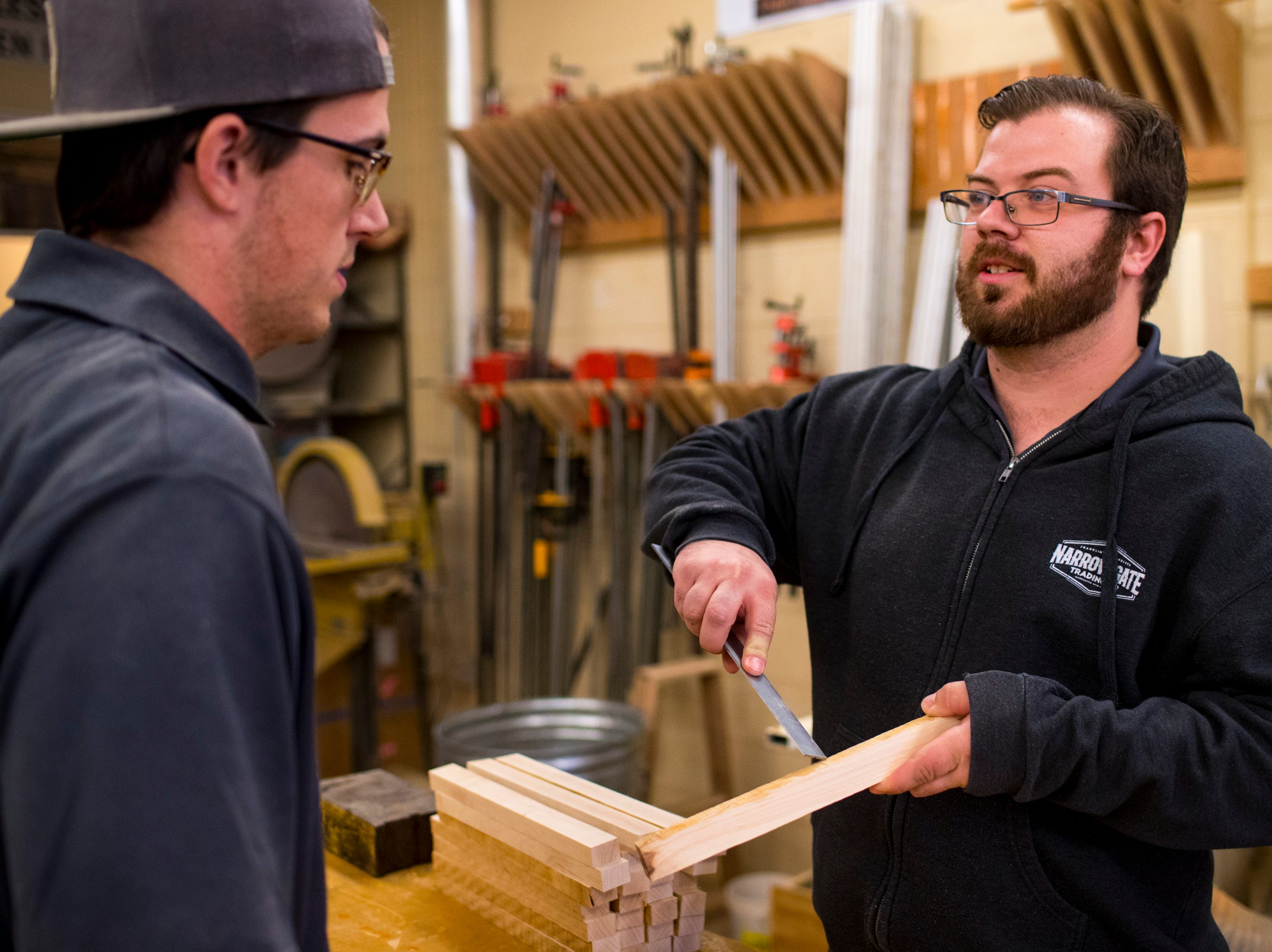TN Box Beams representative Kenny Bowling, right, gives guidance to Heath Hill at TN Box Beam in Franklin on Friday, Nov. 9, 2018. TN Box Beams will be featured on the HGTV show Property Brothers Buying + Selling on Nov. 14.