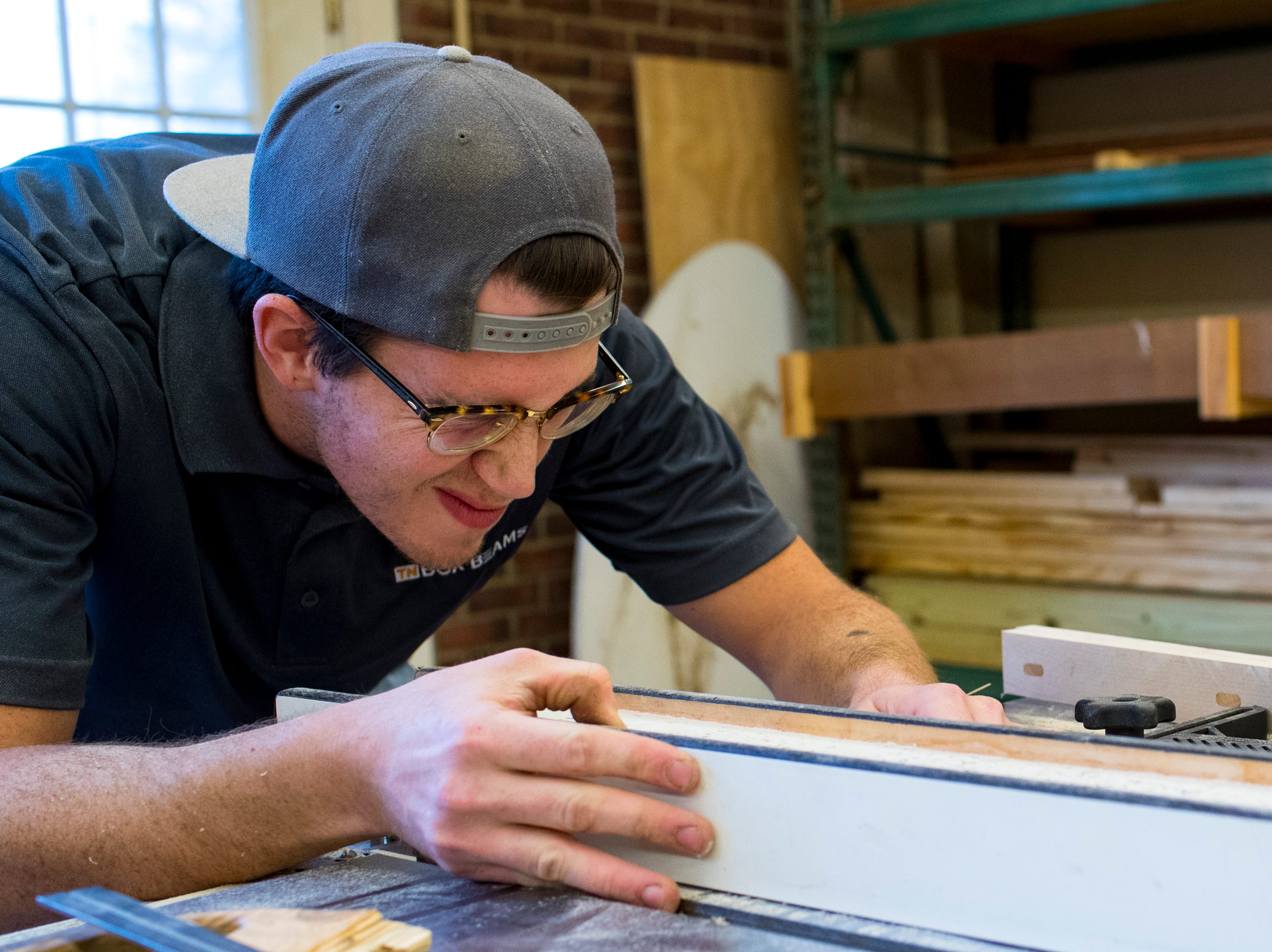 Heath Hill prepares to make a cut on a table saw at TN Box Beams in Franklin on Friday, Nov. 9, 2018. TN Box Beams will be featured on the HGTV show Property Brothers Buying + Selling on Nov. 14.