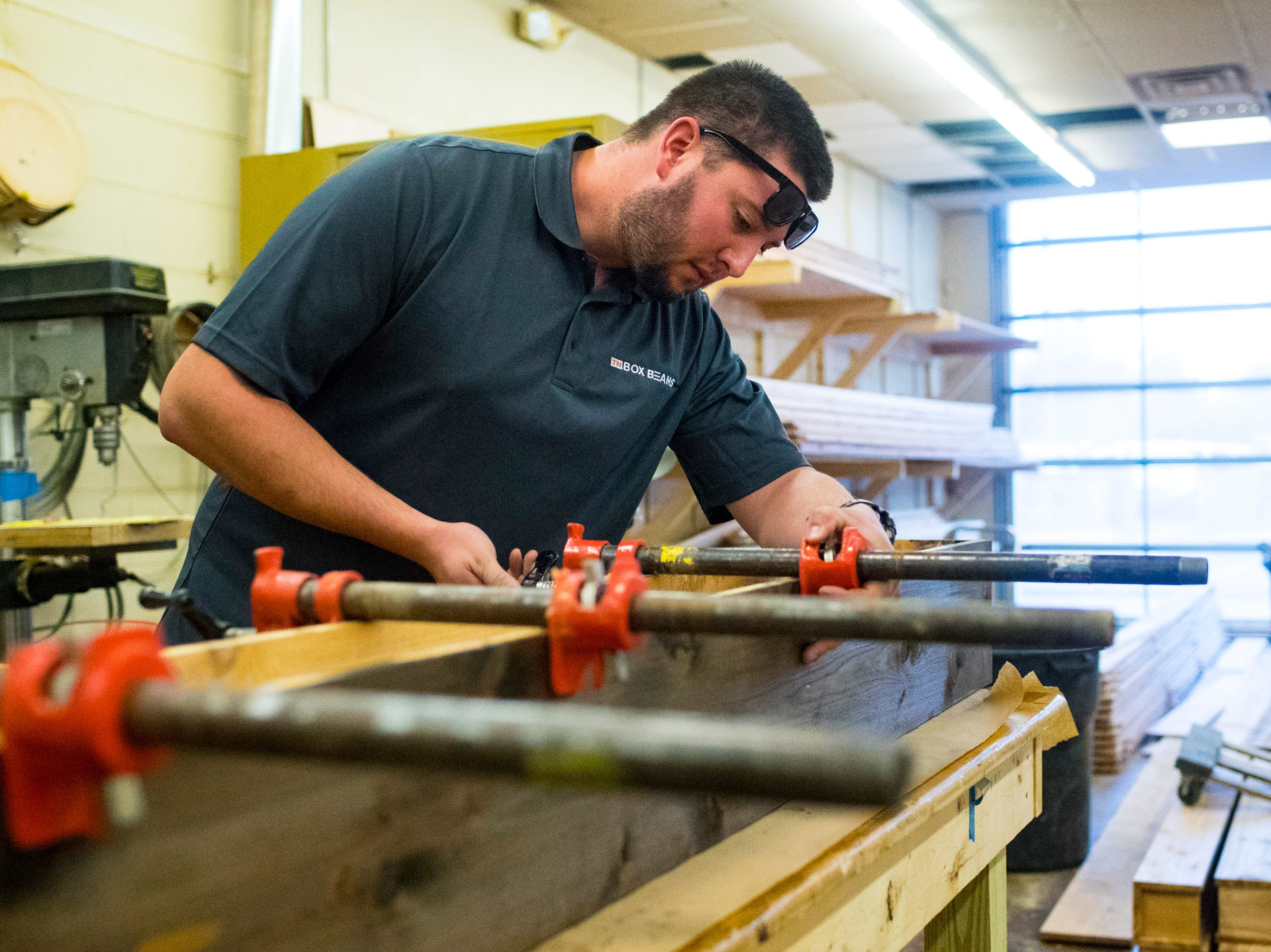 Colin Hemberg works on a beam at TN Box Beams in Franklin on Friday, Nov. 9, 2018. TN Box Beams will be featured on the HGTV show Property Brothers Buying + Selling on Nov. 14.
