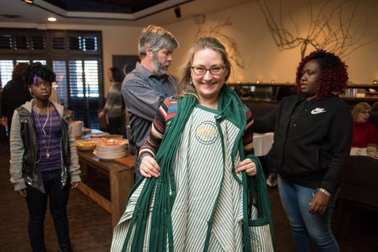 Glenda Hastings, owner of Napa Cafe, recruits friends and customers to help her serve a turkey dinner to those in need at her restaurant every Thanksgiving. She has named the event Donna's Table in honor of her mother.