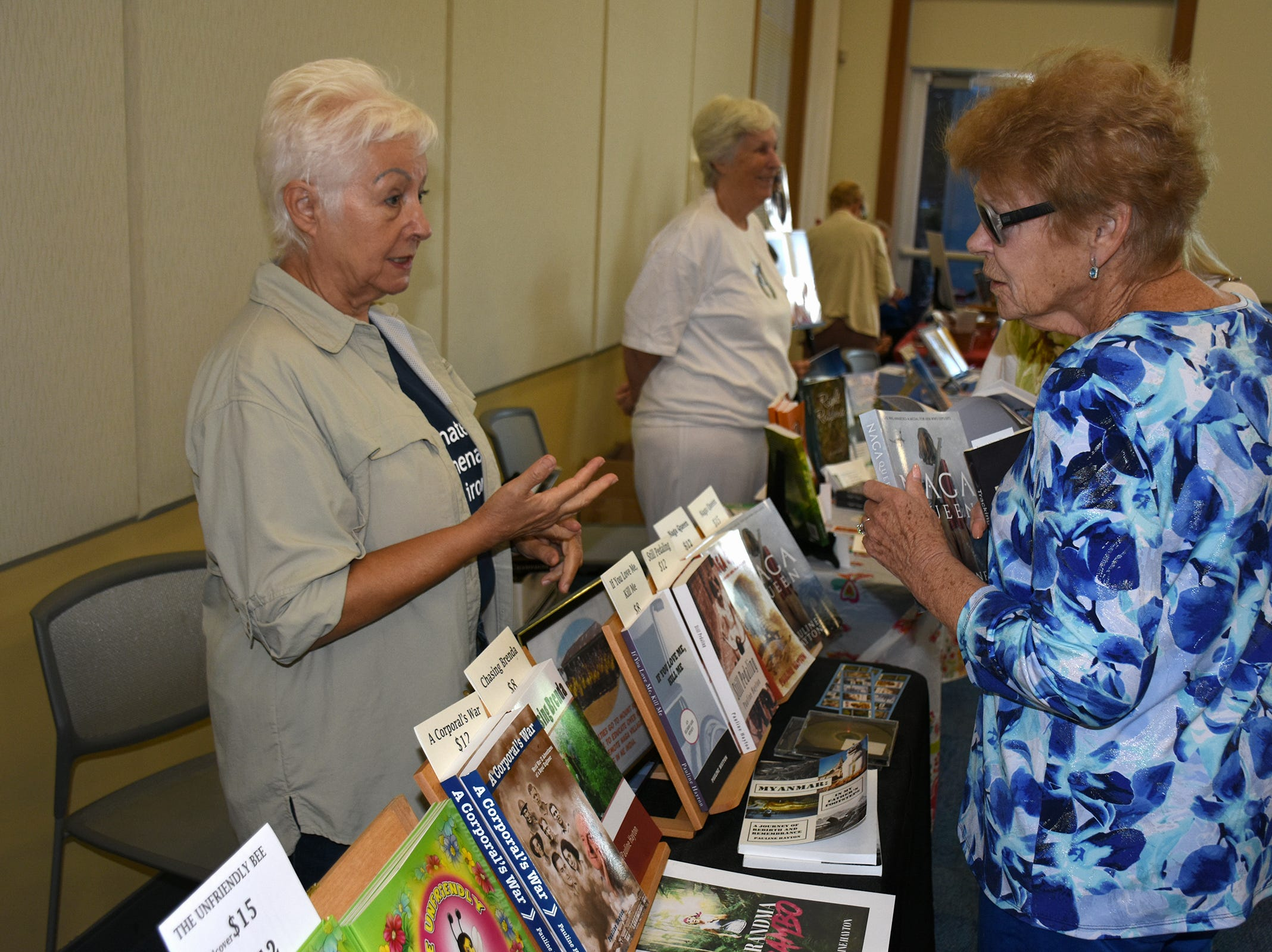 "Pauline Hayton, left, wrote titles including ""If You Love Me, Kill Me: An Eldercare Story."" The Collier County public library system hosted an author fair Saturday at the South Regional library branch, with nearly four dozen local writers and talks from two eminent authors."