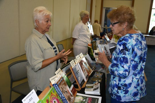 "Pauline Hayton, left, wrote titles including ""If You Love Me, Kill Me: An Eldercare Story."" The Collier County public library system hosted an author fair Nov. 10 at the South Regional library branch, with nearly four dozen local writers and talks from two eminent authors."