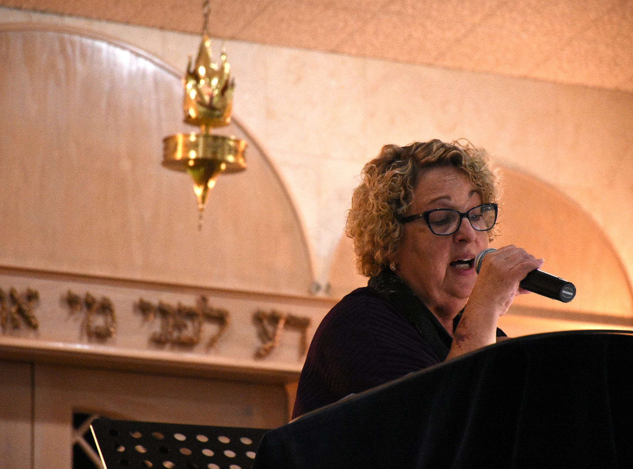 Cantorial soloist Hari Jacobsen sings Hebrew psalms. The Jewish Congregation of Marco Island held a Shabbat service Friday evening marking the 80th anniversary of Kristallnacht, when Nazi Germany brought perseution of Jews out into the open.