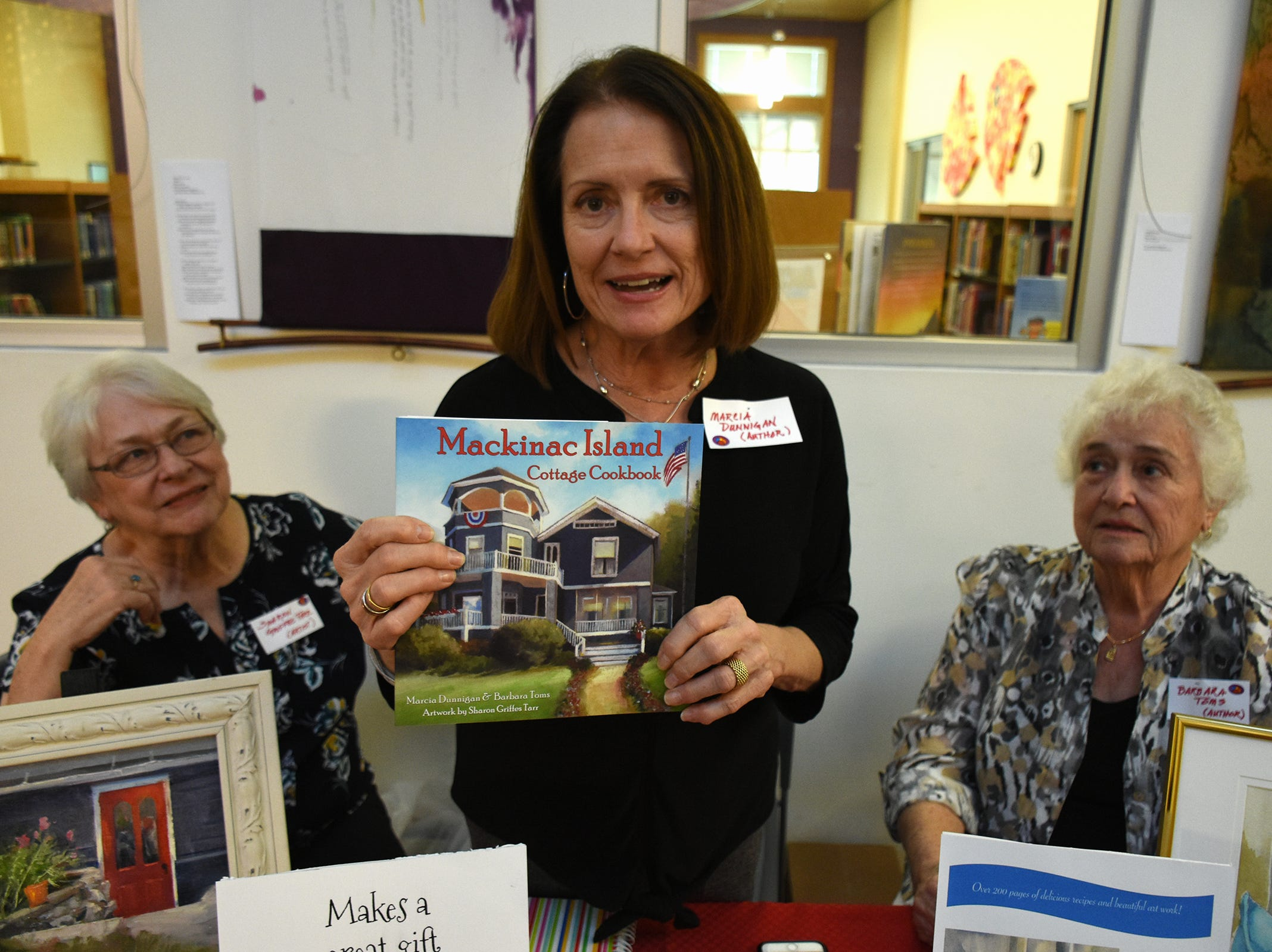 Family members Marcia Dunnigan, center, Barbara Toms, and Sharon Griffen Tarr collaborated on this cookbook. The Collier County public library system hosted an author fair Saturday at the South Regional library branch, with nearly four dozen local writers and talks from two eminent authors.