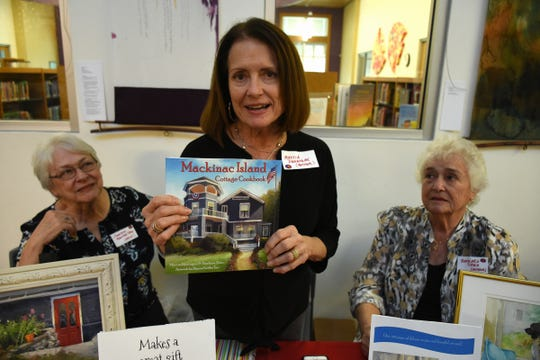 Family members Marcia Dunnigan, center, Barbara Toms, and Sharon Griffen Tarr collaborated on this cookbook. The Collier County public library system hosted an author fair Nov. 10 at the South Regional library branch, with nearly four dozen local writers and talks from two eminent authors.