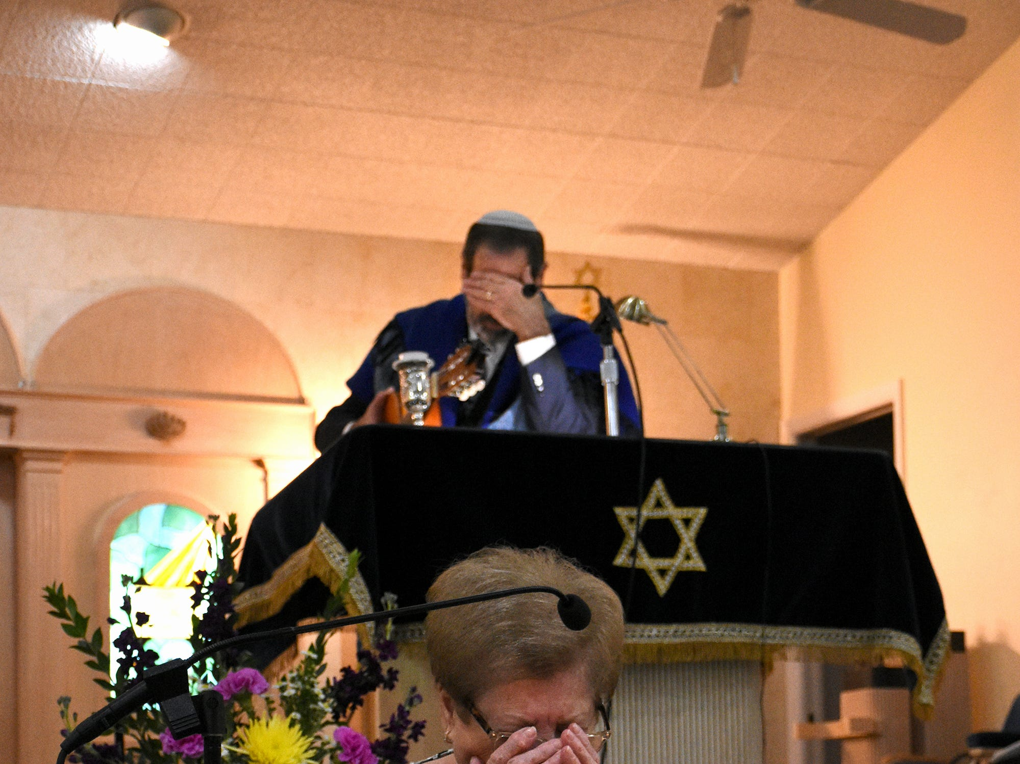 Eta Gluzband and Rabbi Mark Gross react with emotion. The Jewish Congregation of Marco Island held a Shabbat service Friday evening marking the 80th anniversary of Kristallnacht, when Nazi Germany brought perseution of Jews out into the open.