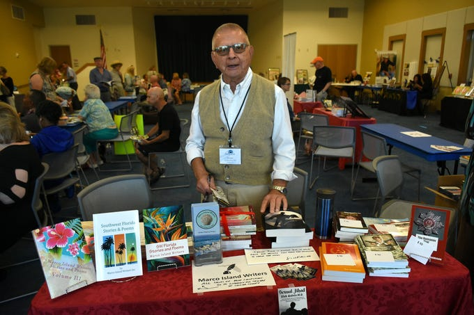 """Sexual Jihad"" author Nick Kalvin mans the table for the Marco Island Writers group. The Collier County public library system hosted an author fair Saturday at the South Regional library branch, with nearly four dozen local writers and talks from two eminent authors."