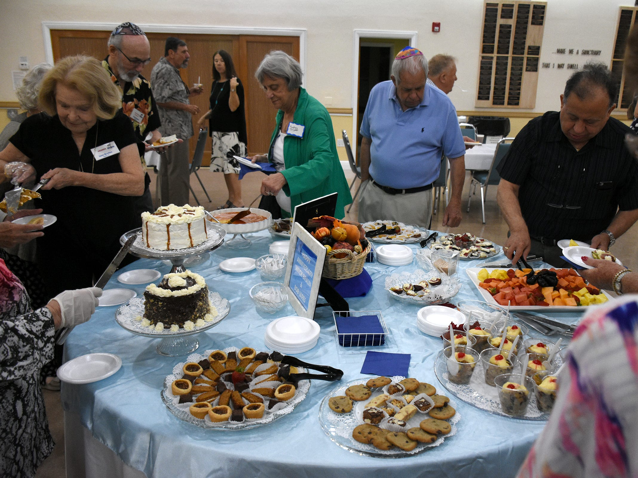 After the ceremony, everyone steps into an adjoining room for oneg, a little nosh. The Jewish Congregation of Marco Island held a Shabbat service Friday evening marking the 80th anniversary of Kristallnacht, when Nazi Germany brought perseution of Jews out into the open.