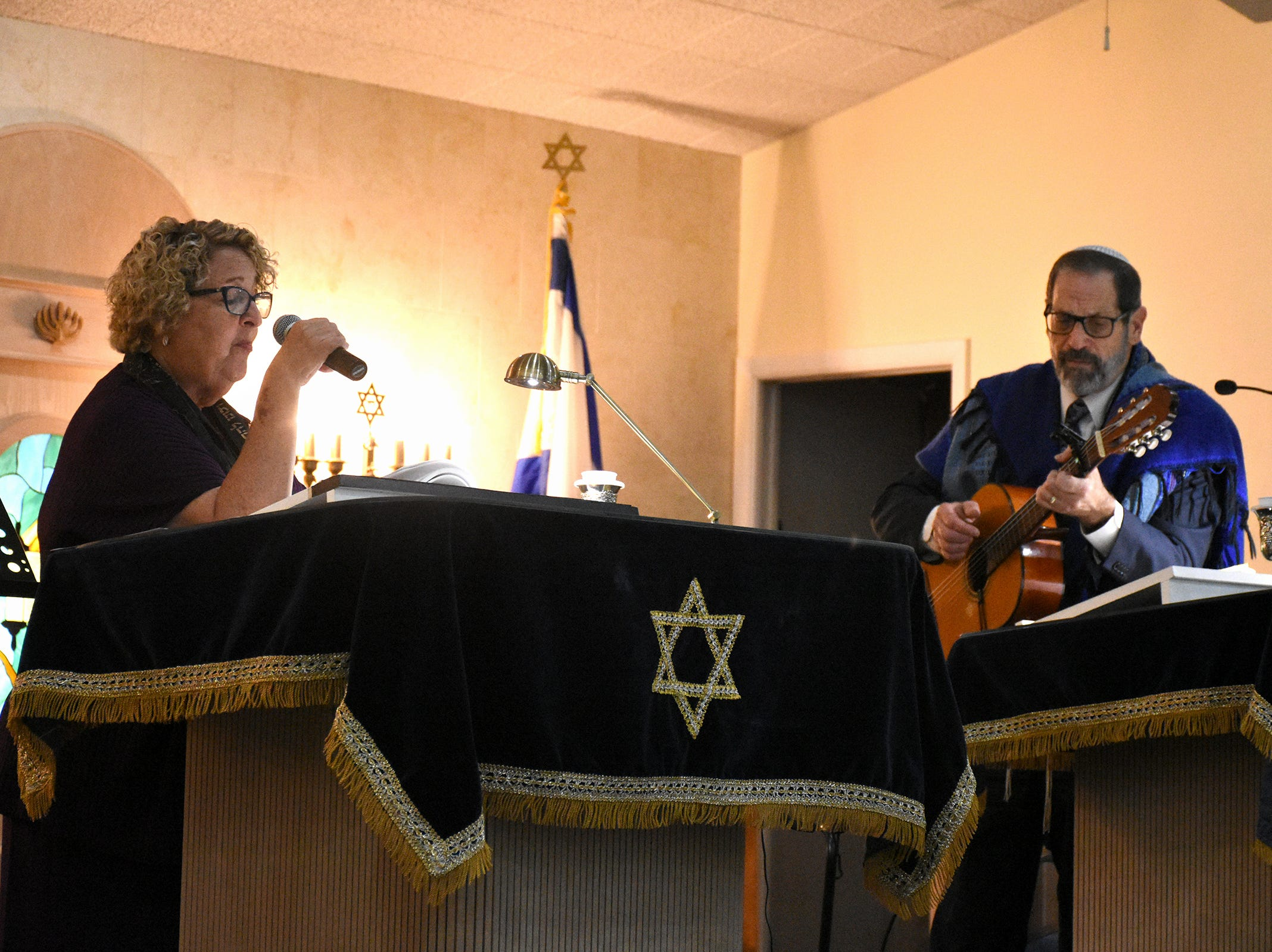 Rabbi Mark Gross accompanies cantor Hari Jacobsen. The Jewish Congregation of Marco Island held a Shabbat service Friday evening marking the 80th anniversary of Kristallnacht, when Nazi Germany brought perseution of Jews out into the open.