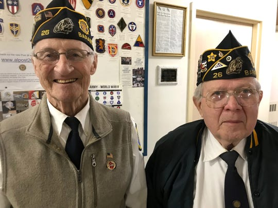 Phil Stopper, 84, a Korean War veteran, (left) and Cliff Rabuck, 78, an Army veteran during the Vietnam Era, took part in Baraboo's Veterans Day ceremony Monday. They were outraged to see Baraboo High School students posing for a prom picture with arms raised in Nazi salutes.