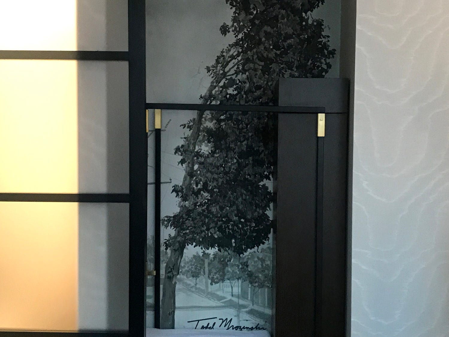 When you open the closets to hang up your clothes at the Saint Kate arts-focused hotel, you may find trees painted by Milwaukee artist Todd Mrozinski.
