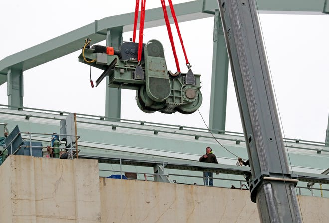 A crane lifts one of the 34-ton bogies that move the large roof panels at Miller Park in Milwaukee on Monday.  It's part of $900,000 repair project to replace a 2-foot diameter wheel bearing on the unit. The repair will take place at the Falk Corp. in Milwaukee. The entire process is expected to take seven to 10 days.