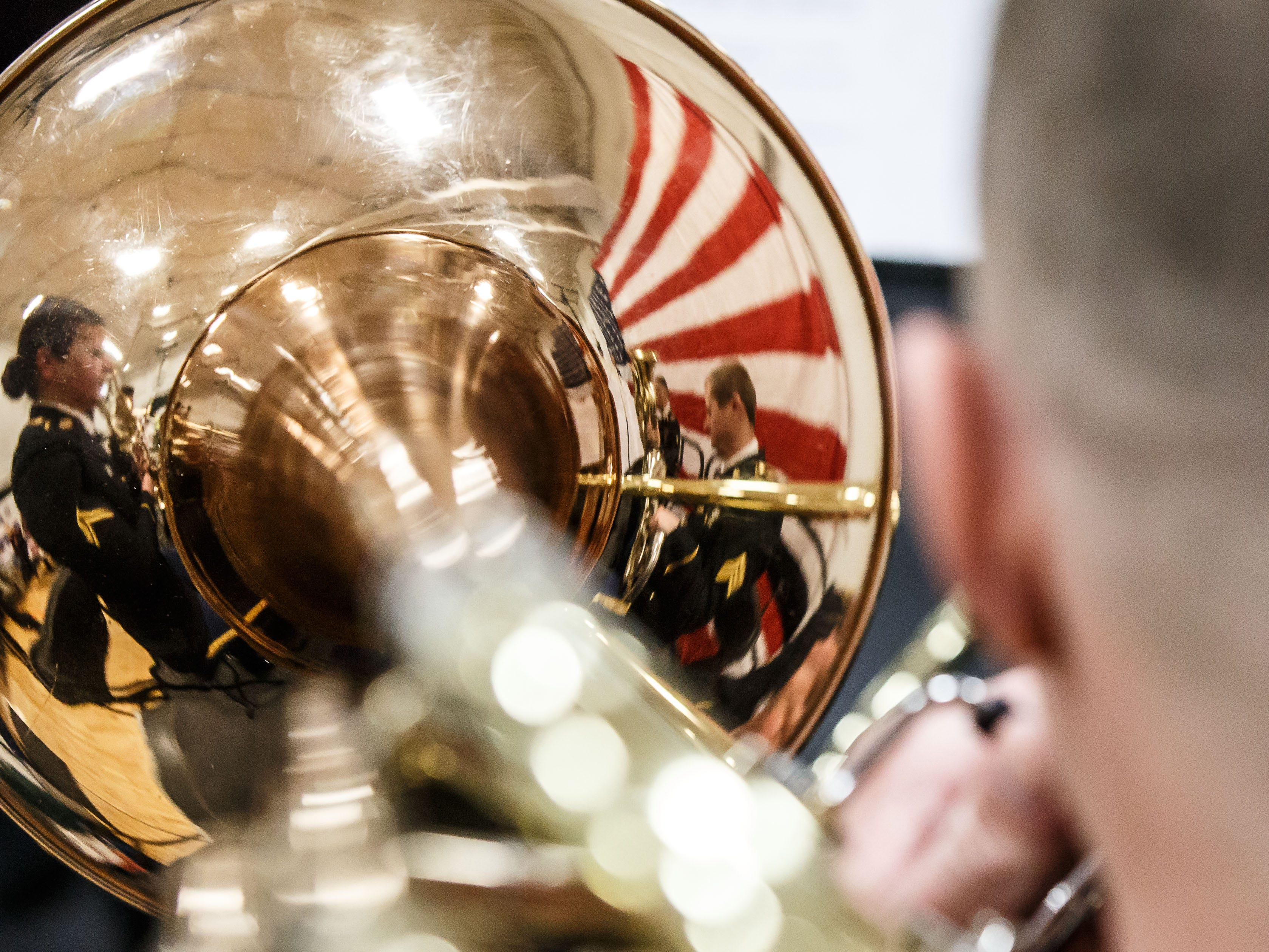 A flag reflects on the bell of a horn as the 132nd Wisconsin Army National Guard Band performs at the seventh annual Operation Honor: A Salute to Veterans in Waukesha on Saturday, Nov. 10, 2018.