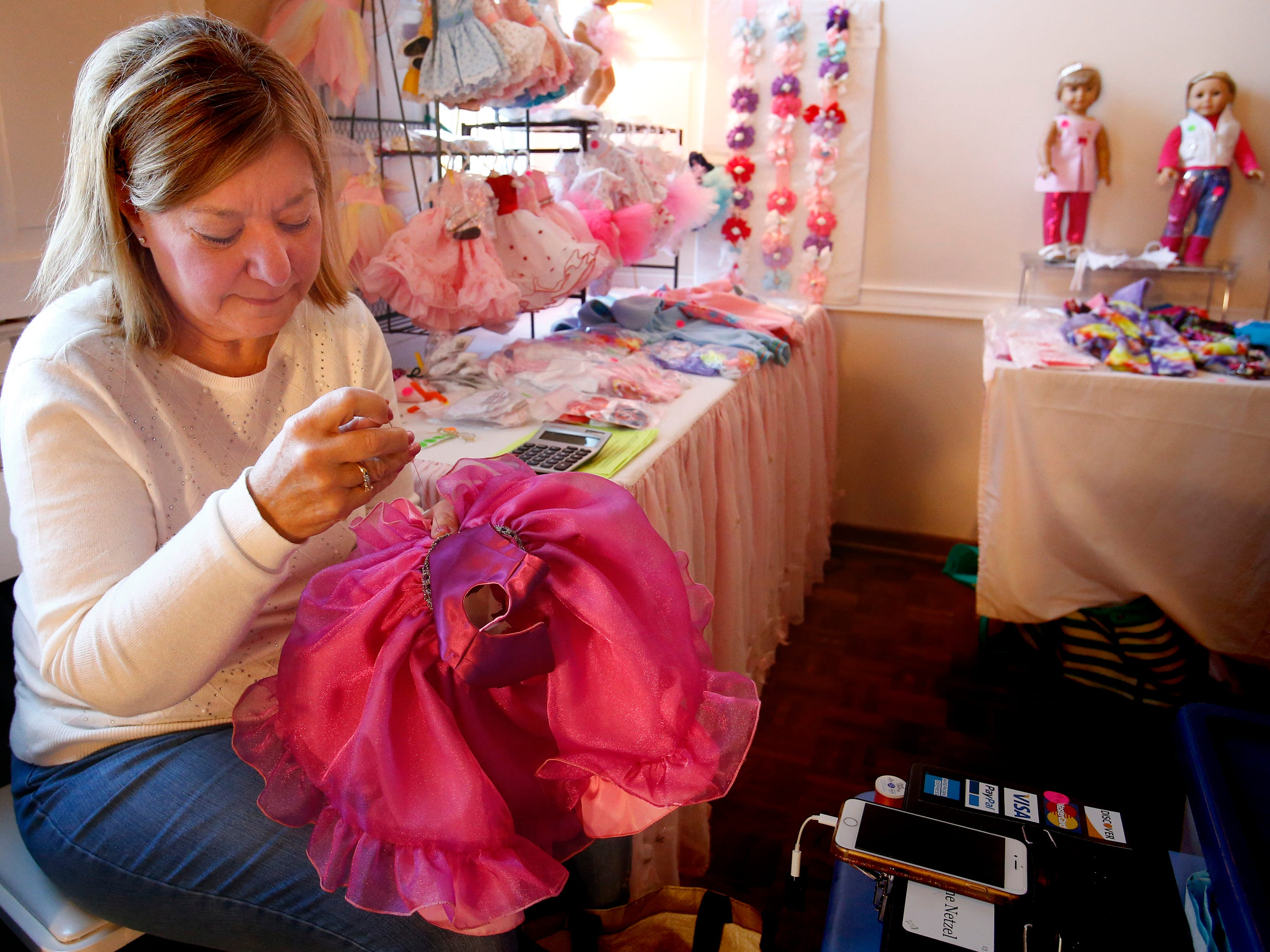 Janine Netzel continues to stitch together doll dresses at The Elm Grove Woman's Club Crafts and Art Show during Elm Grove's Holiday Open House on Nov. 10