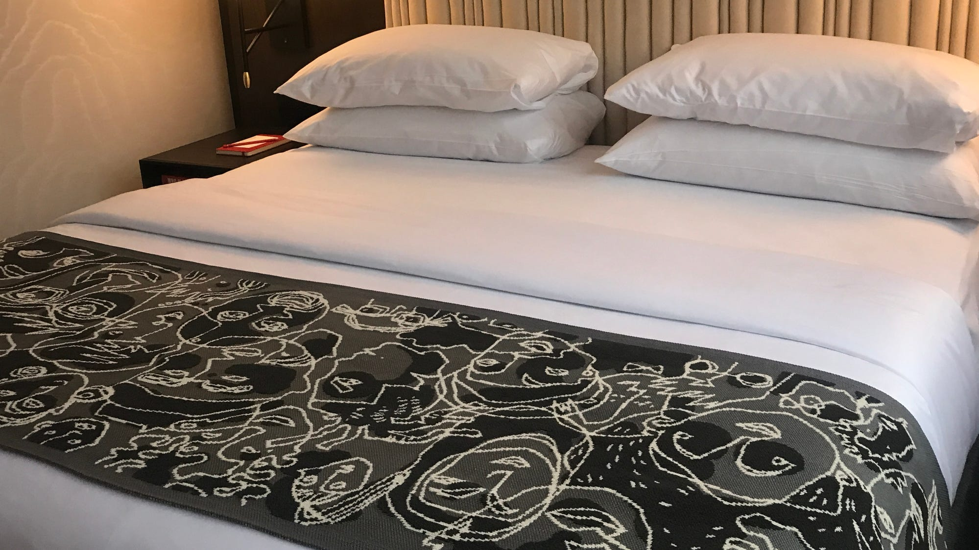 At the foot of every bed at the Saint Kate hotel...