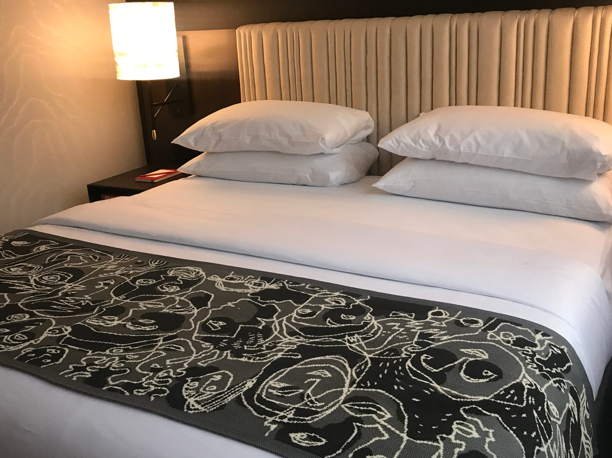 At the foot of every bed at the Saint Kate hotel will be a throw designed by Milwaukee artist Christiane Grauert.