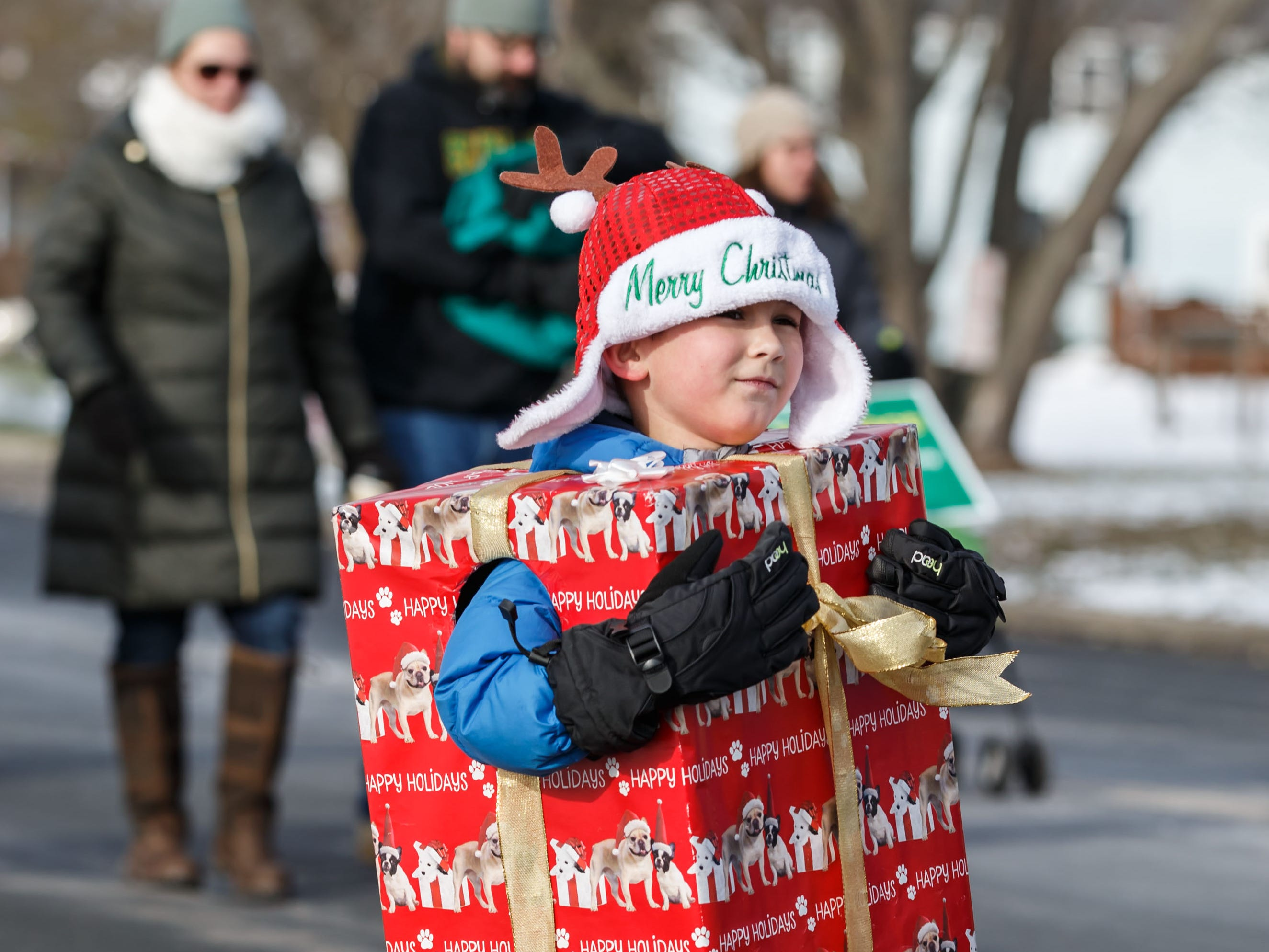 First grader Cole Starner of St. Boniface Parish and School scampers past as the annual Germantown Christmas Parade makes it's way down Squire Dr. on Saturday, Nov. 10, 2018.