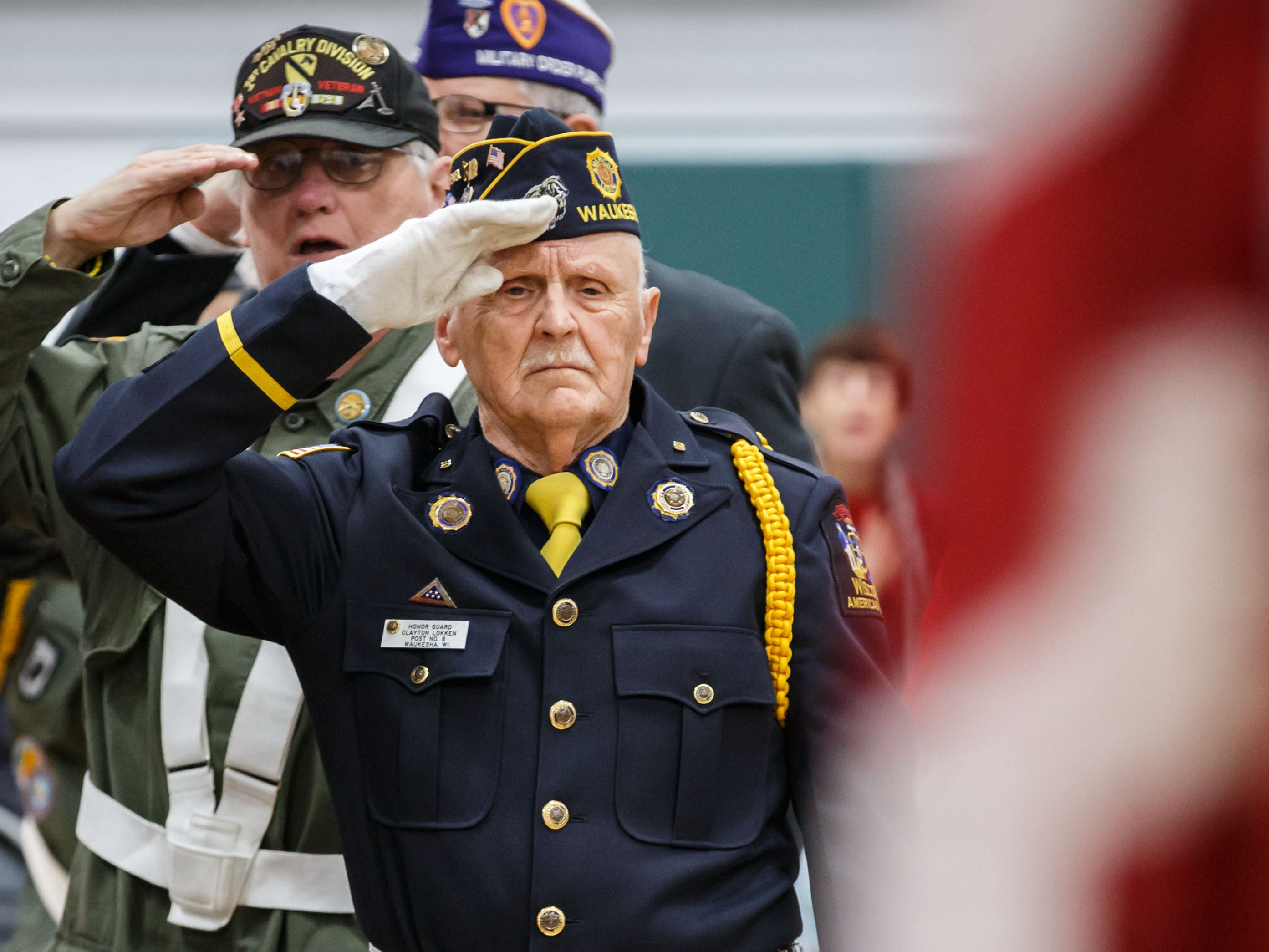 Honor Guard Clayton Lokken of American Legion Post 8 salutes the flag during the seventh annual Operation Honor: A Salute to Veterans at the Schuetze Recreation Center in Waukesha on Saturday, Nov. 10, 2018.
