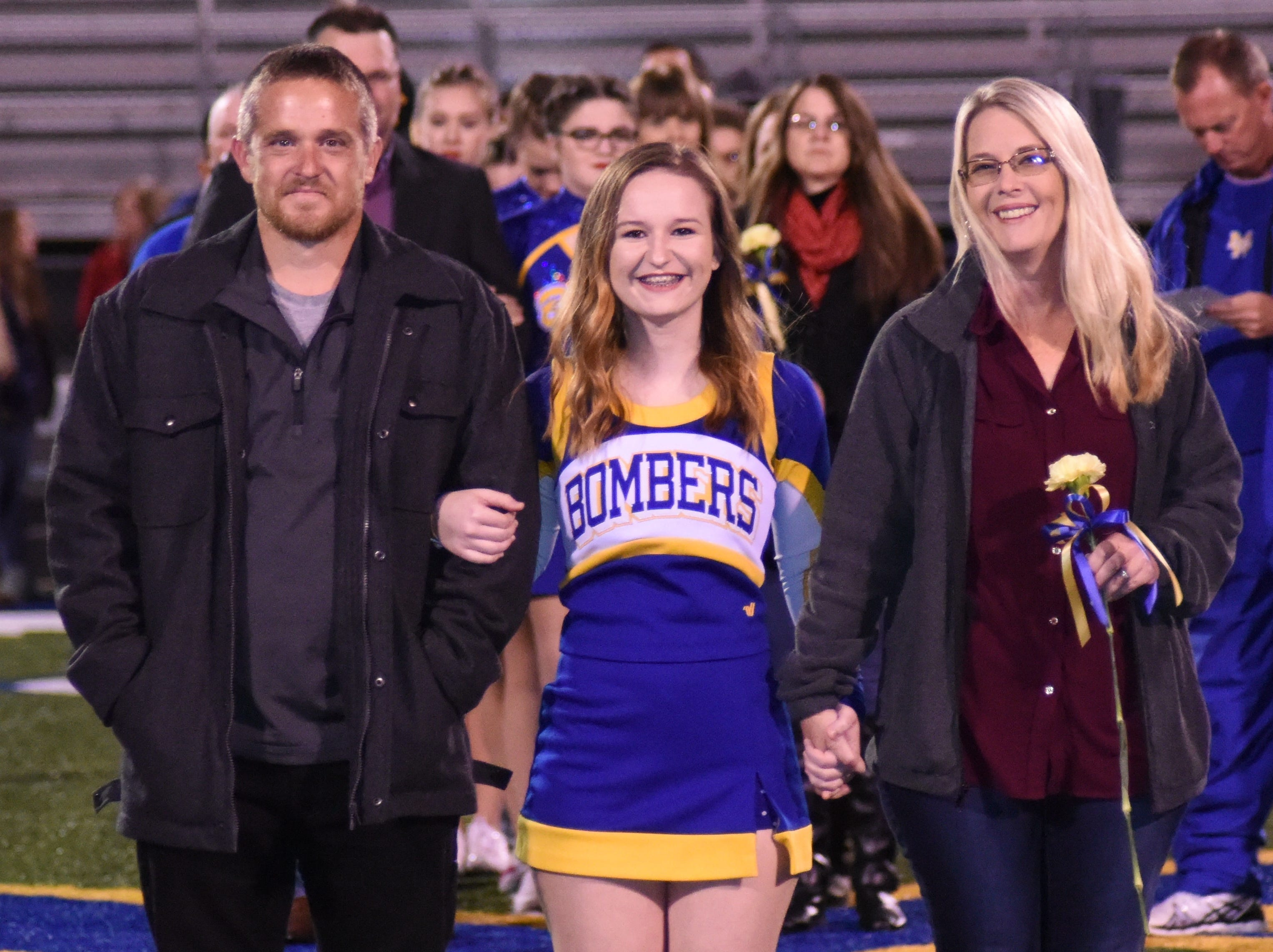 Seharra Spurlock and her parents, Darci and Jared Domerese.