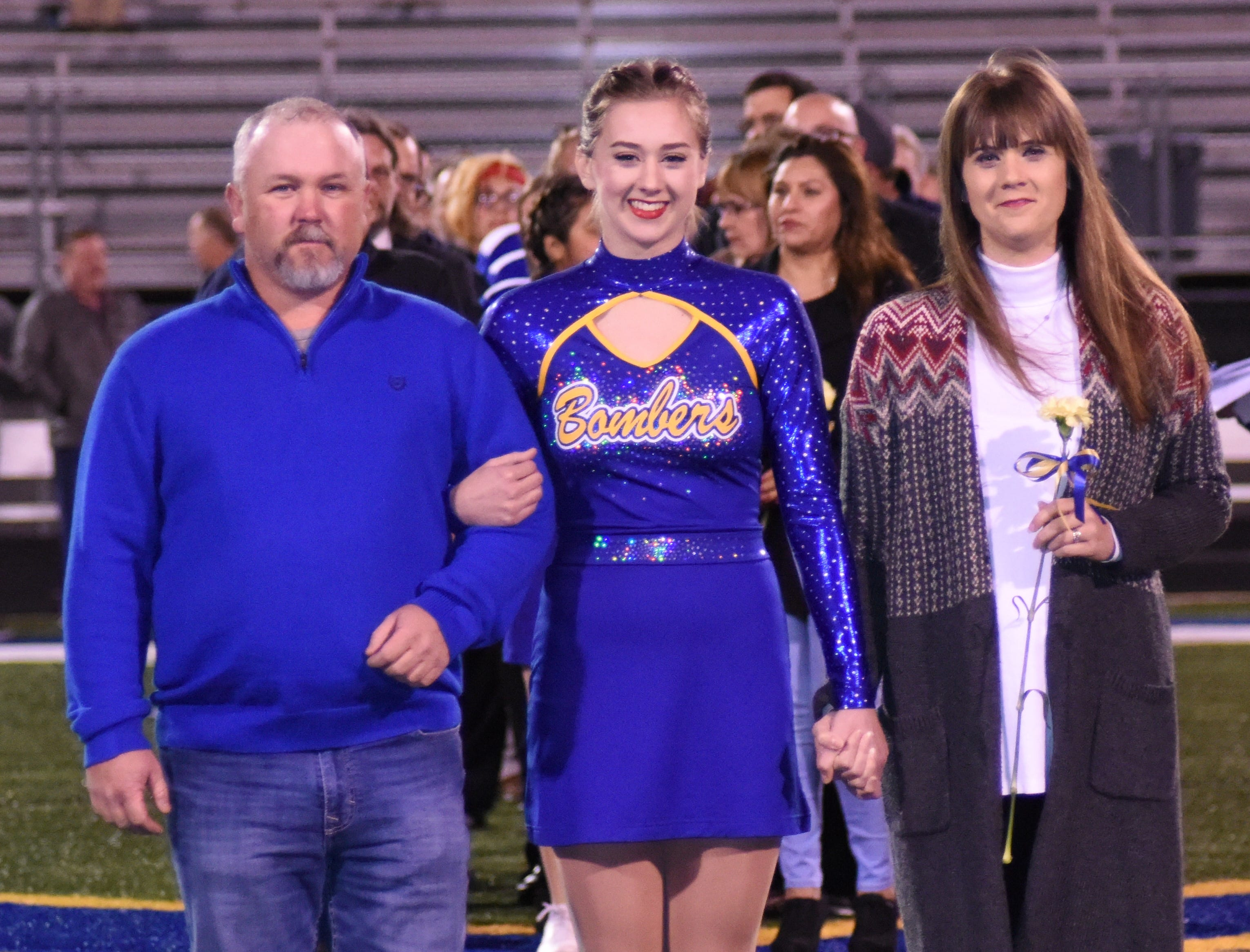 Mackenzie Drewry and her parents, David and Jennifer Drewry.