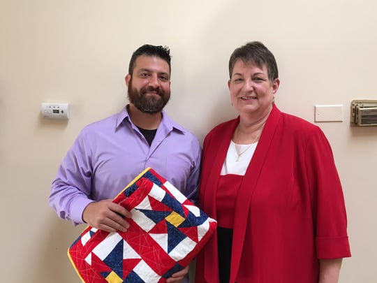 "Michael Scuzzese, a former Army sergeant honored with a ""Valor Quilt,"" and Cheryl Doltz, mother of Spc. Ryan Doltz, who was killed in Iraq in 2004."