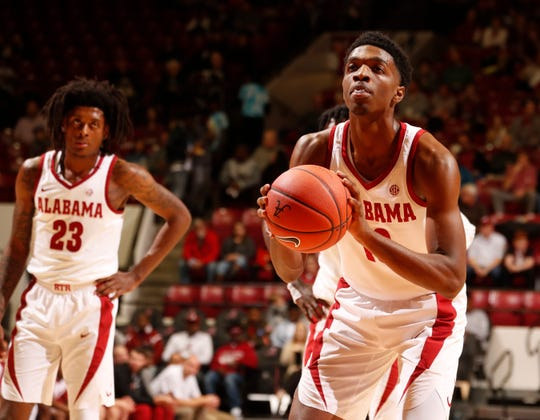 Alabama sophomore wing Herbert Jones (10) takes a free throw shot as fellow sophomore John Petty (23) looks on in a game against Appalachian State on Nov. 11, 2018 from Coleman Coliseum in Tuscaloosa, Ala. (Photo by Robert Sutton/Alabama athletics)