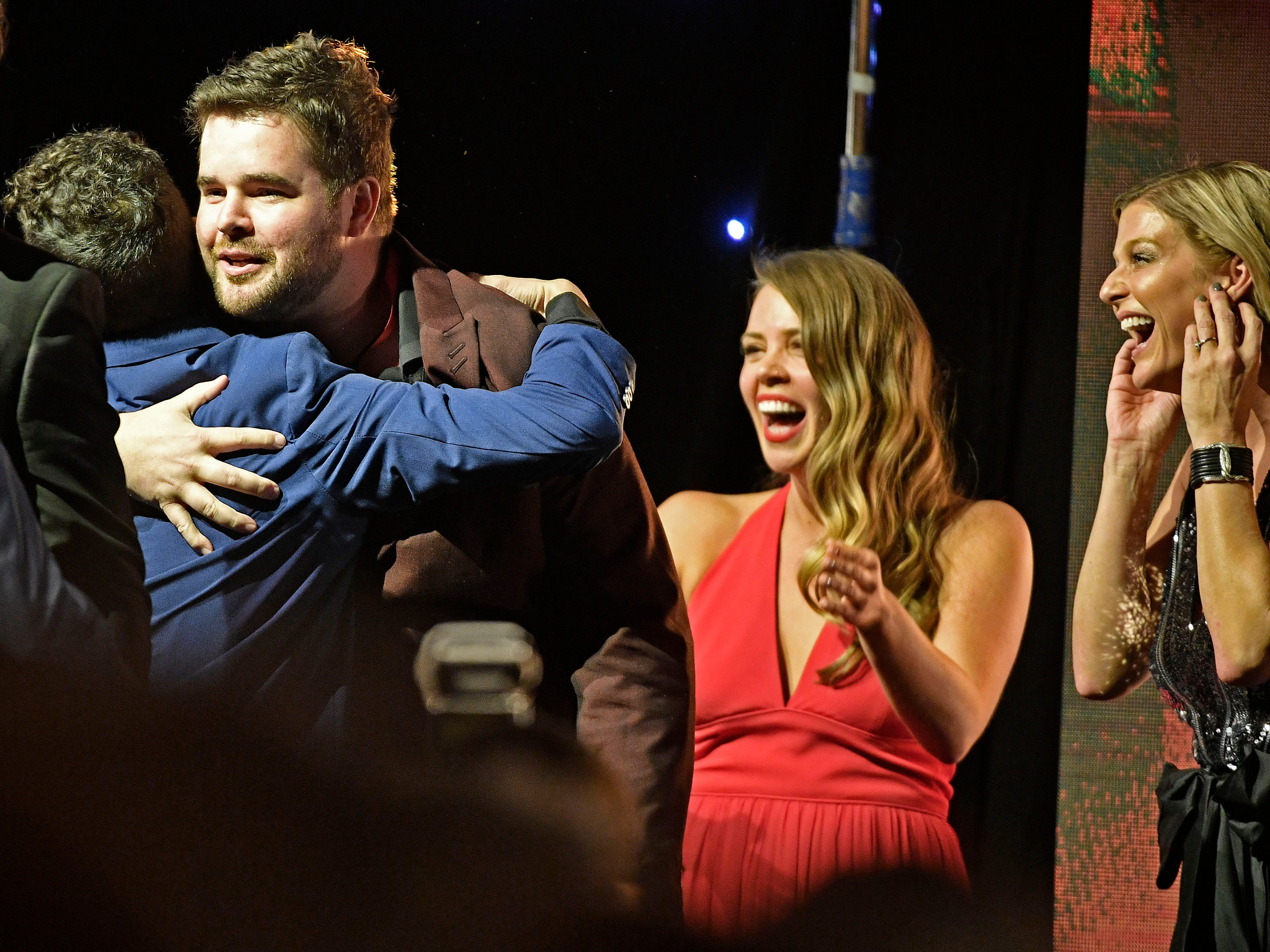Matt McGinn is congratulated after being named Songwriter of the Year at the SESAC Nashville Music Awards at the Country Music Hall of Fame and Museum Sunday Nov. 11, 2018, in Nashville, Tenn.