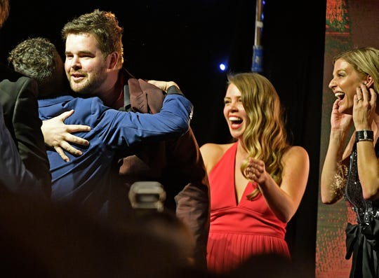 Matt McGinn is congratulated after being named Songwriter of the Year at the SESAC Nashville Music Awards at the Country Music Hall of Fame and Museum on Sunday.