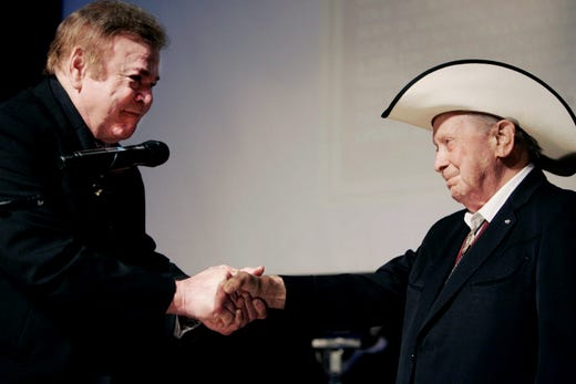 Roy Clark, left, is inducted by Hall of Fame member Little Jimmy Dickens during the Country Music Hall of Fame's Medallion Ceremony on May 17, 2009.