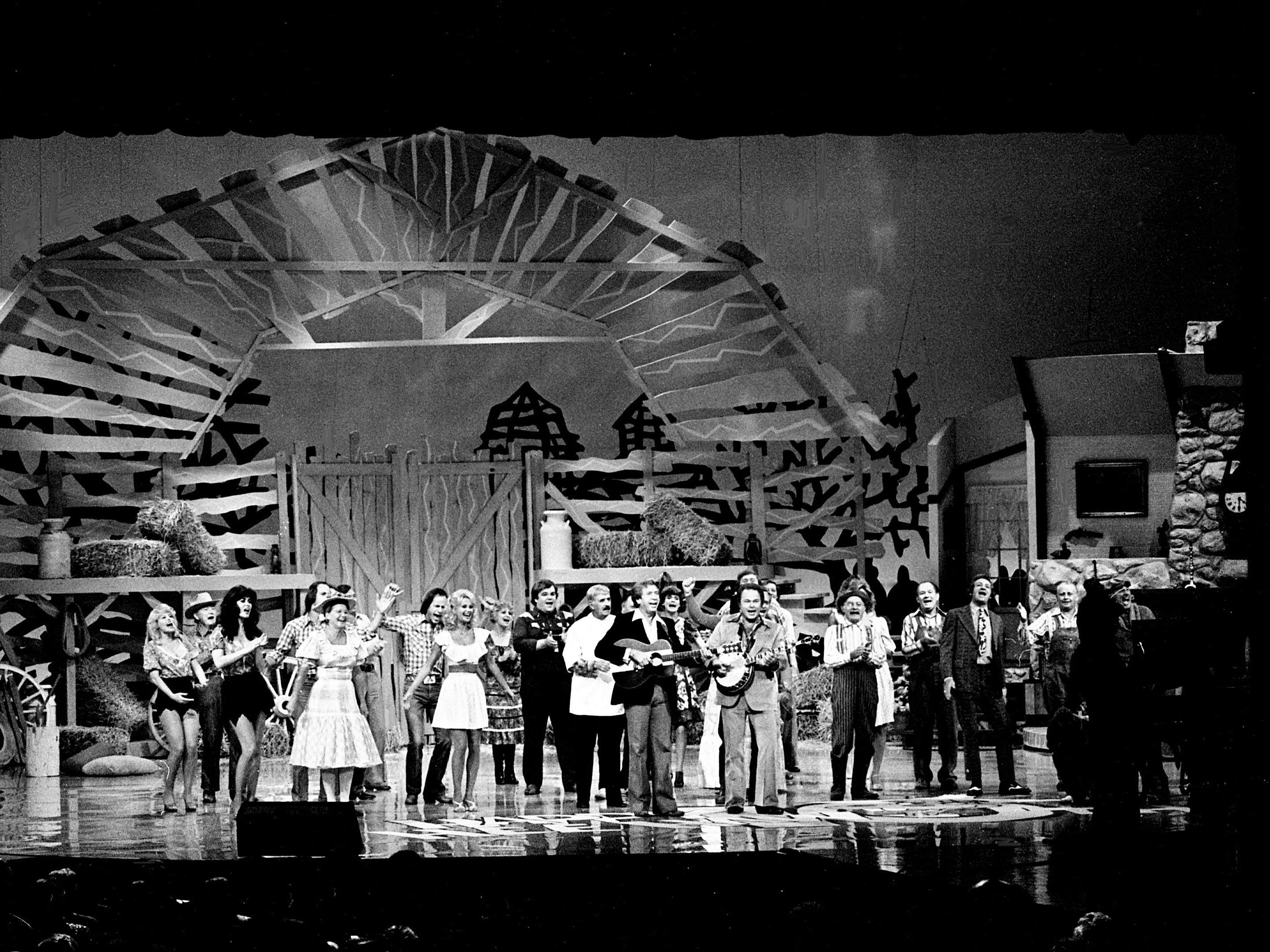 "The entire cast and special guests perform the opening number ""You Are My Hee Haw"" during the taping of the ""Hee Haw Tenth Anniversary Special"" on Sept. 28, 1978, at the Grand Ole Opry House."