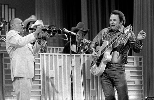 "Roy Clark, right, and Woody Herman perform during a taping of the ""Nashville Palace"" show at Opryland on Sept. 16, 1981."