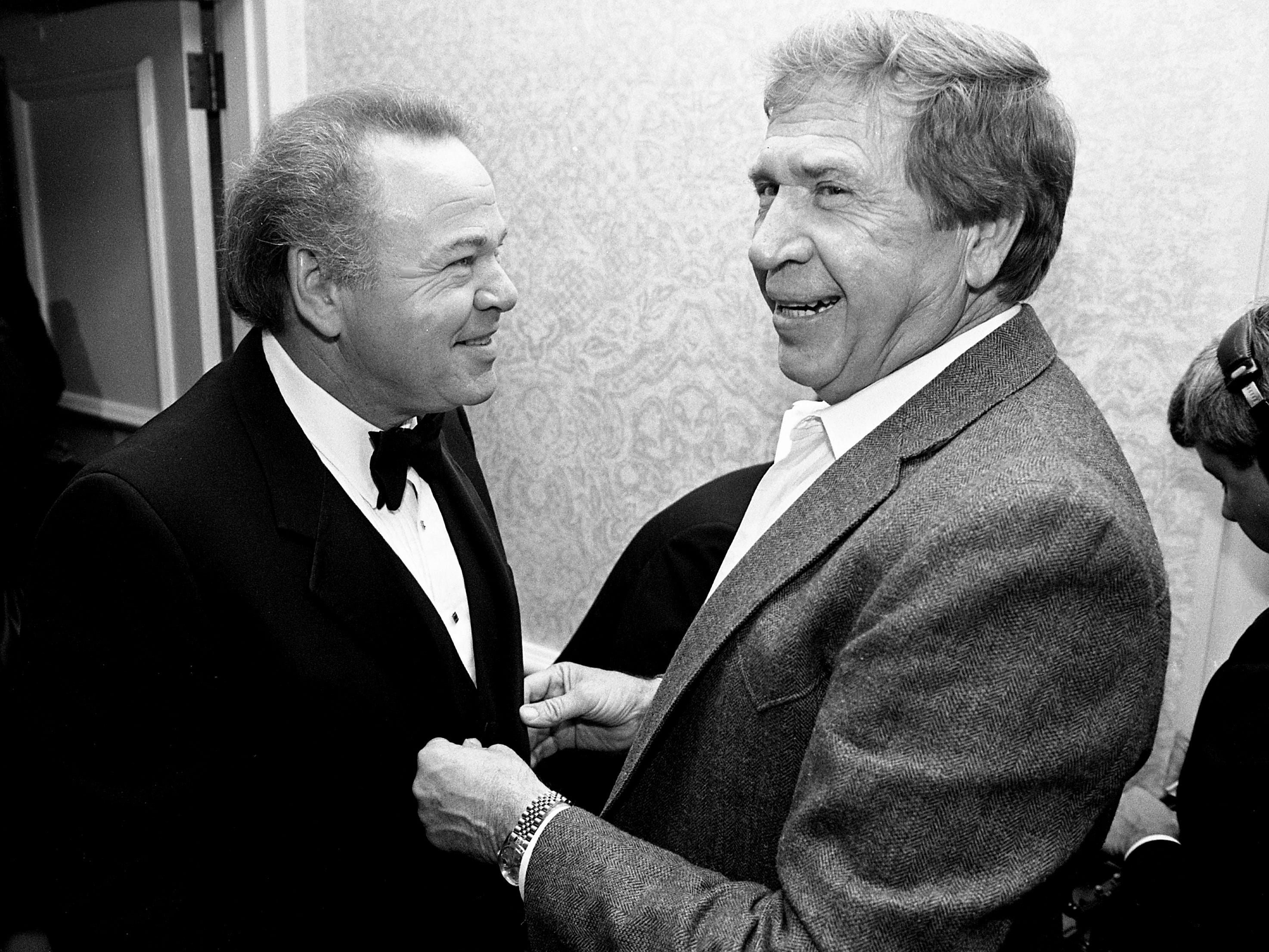 """Hee Haw"" co-host Roy Clark, left, and Buck Owens laugh during a reception and dinner in Clark's honor, ""A Salute to Roy Clark,"" at the Sheraton Music City Hotel on Sept. 9, 1988."