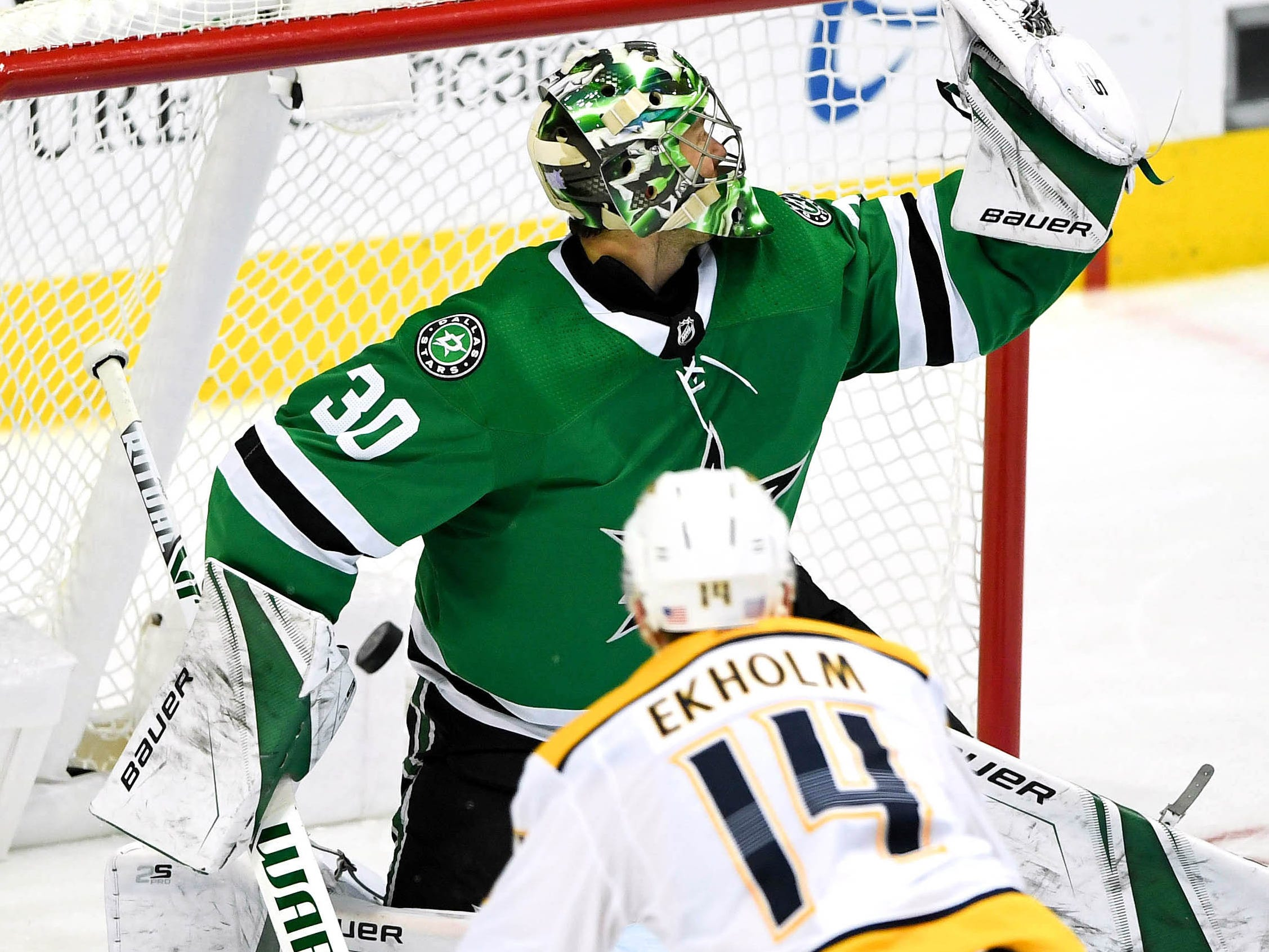 Nov. 10 -- Predators 5, Stars 4/OT -- Nashville Predators defenseman Mattias Ekholm (14) watches his winning goal get past Dallas Stars goaltender Ben Bishop (30) during overtime at American Airlines Center.