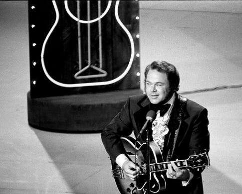 Roy Clark performs at the new Grand Ole Opry House during the eighth annual CMA Awards show Oct. 14, 1974.